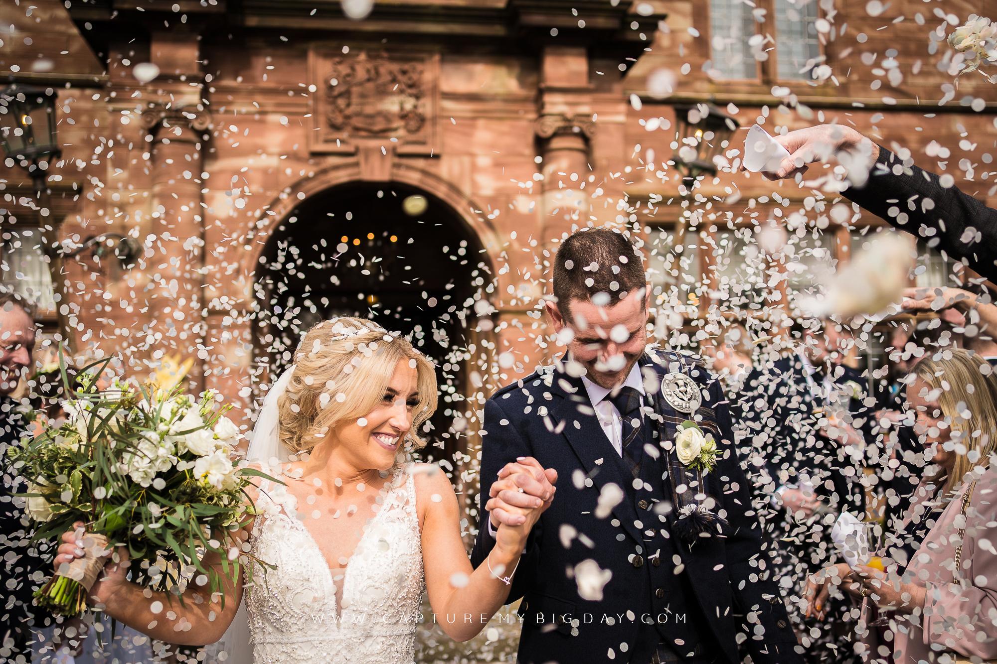 bride and groom covered in confetti