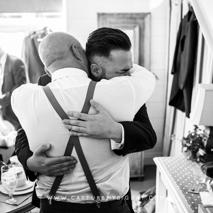 groom hugging
