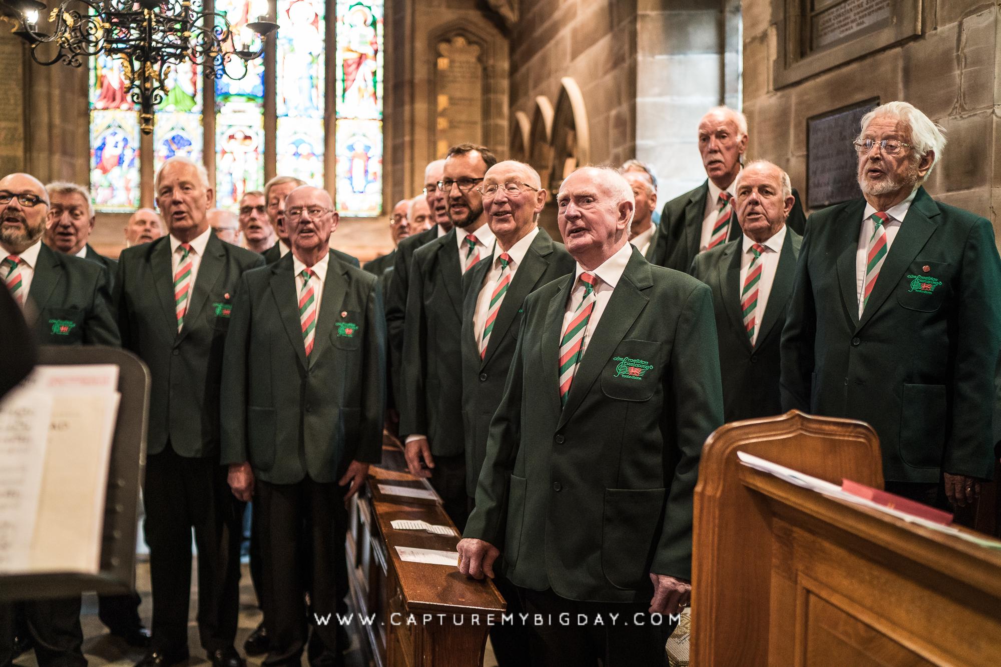 Male choir singing in church