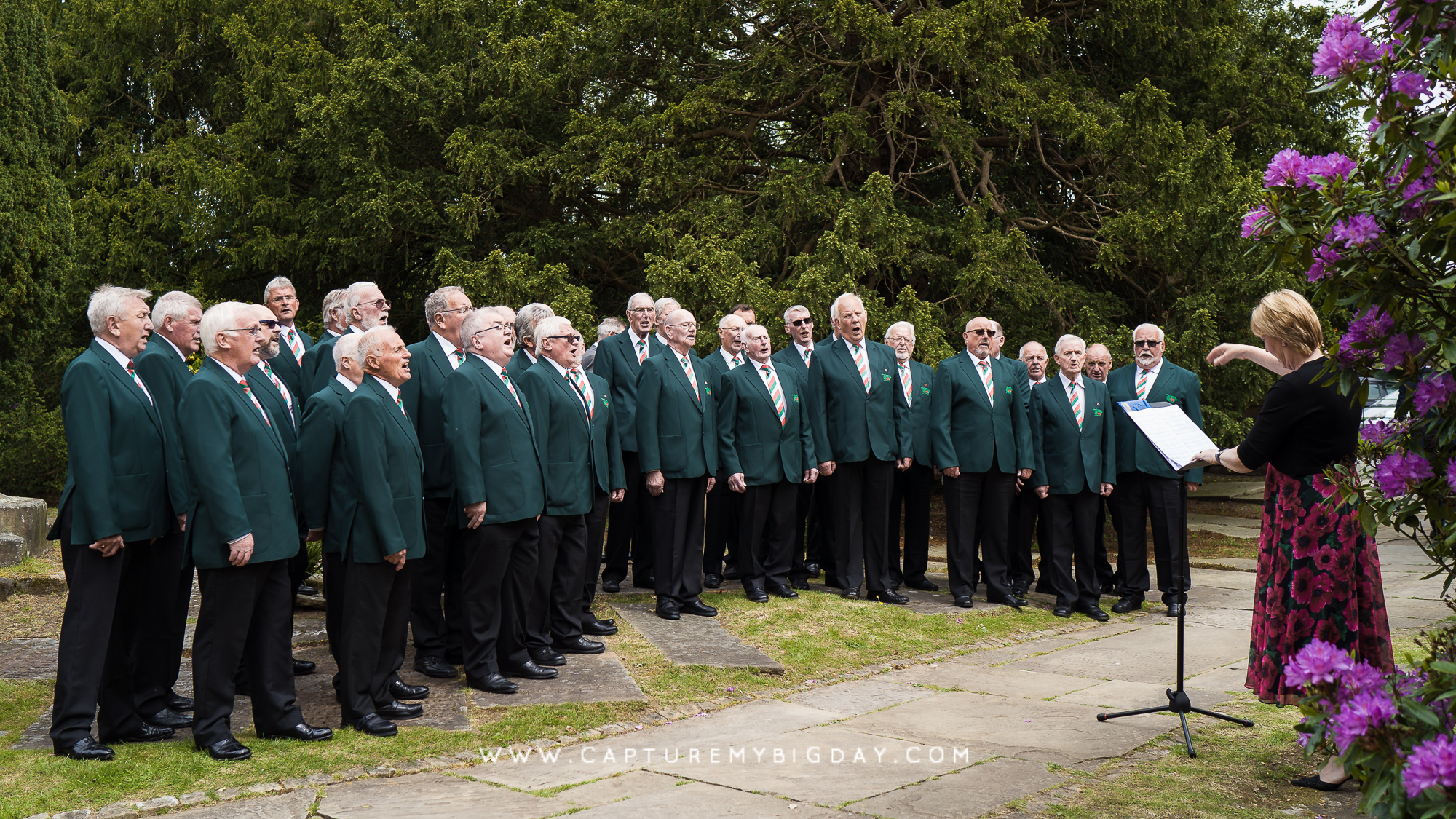 Male choir singing outside church