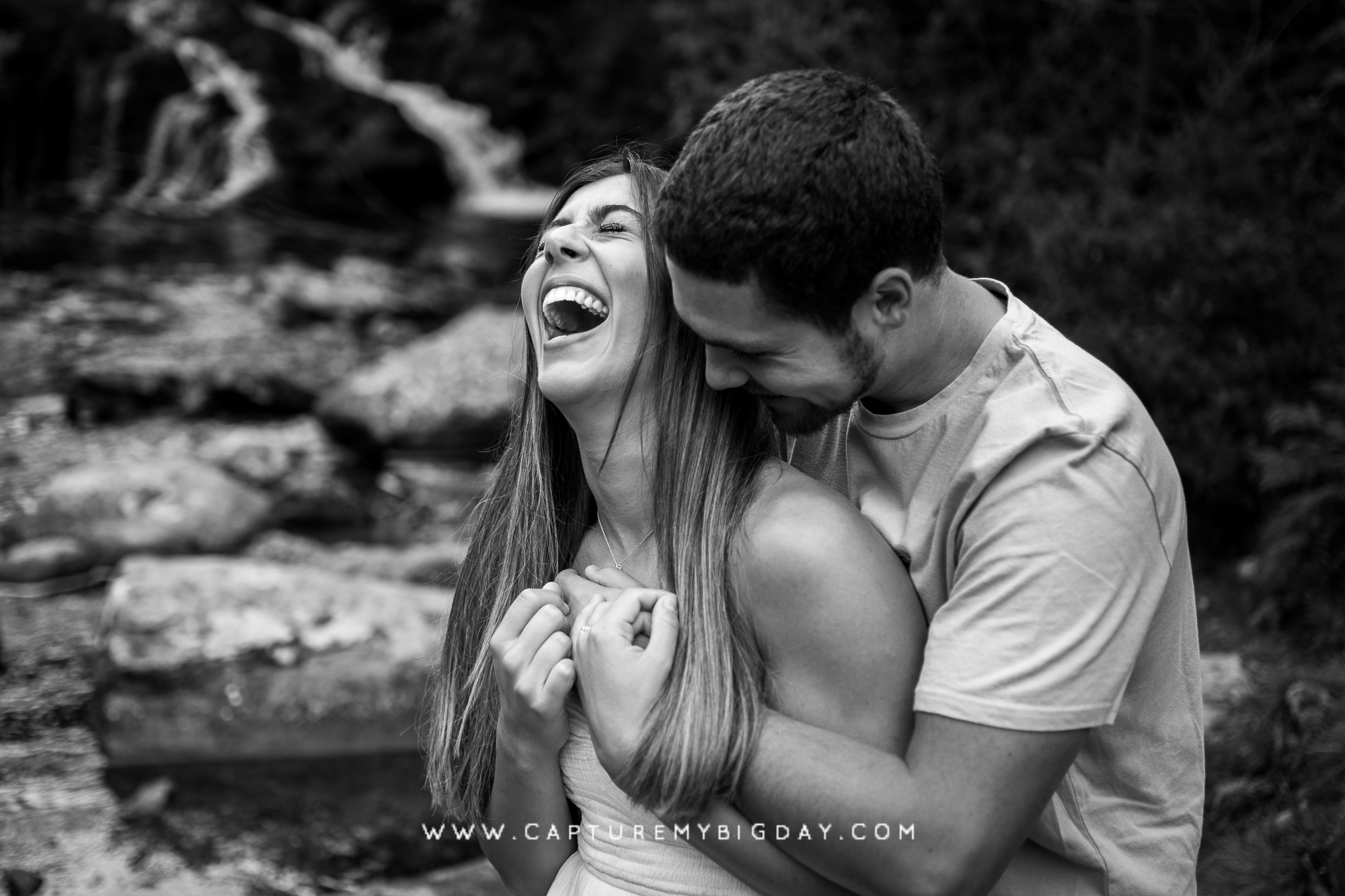 engagement couple laughing