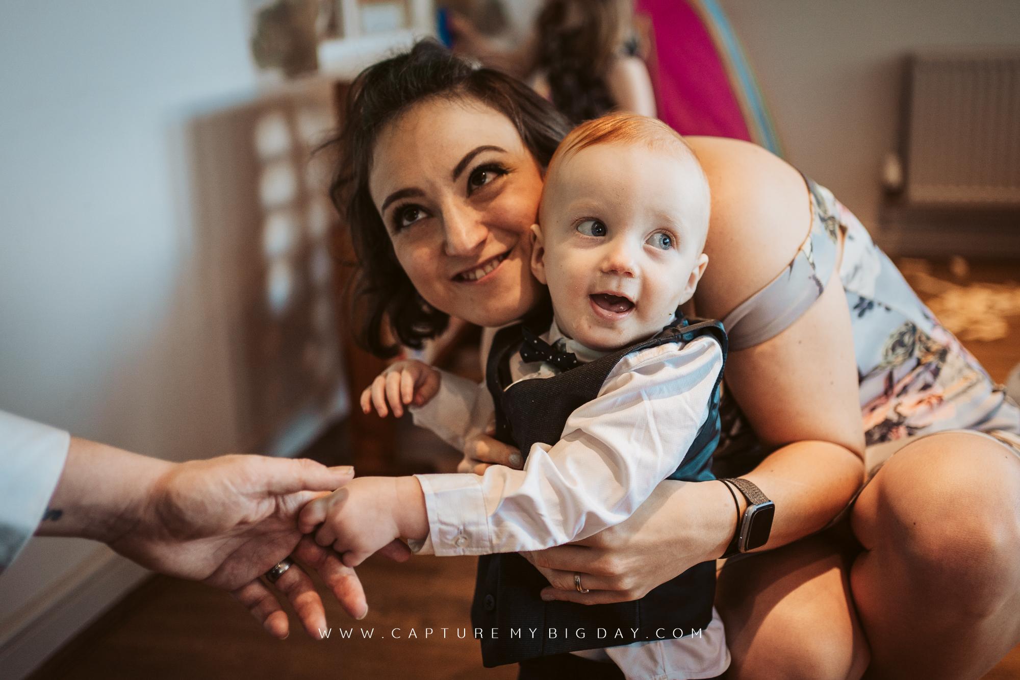 toddler smiling at wedding