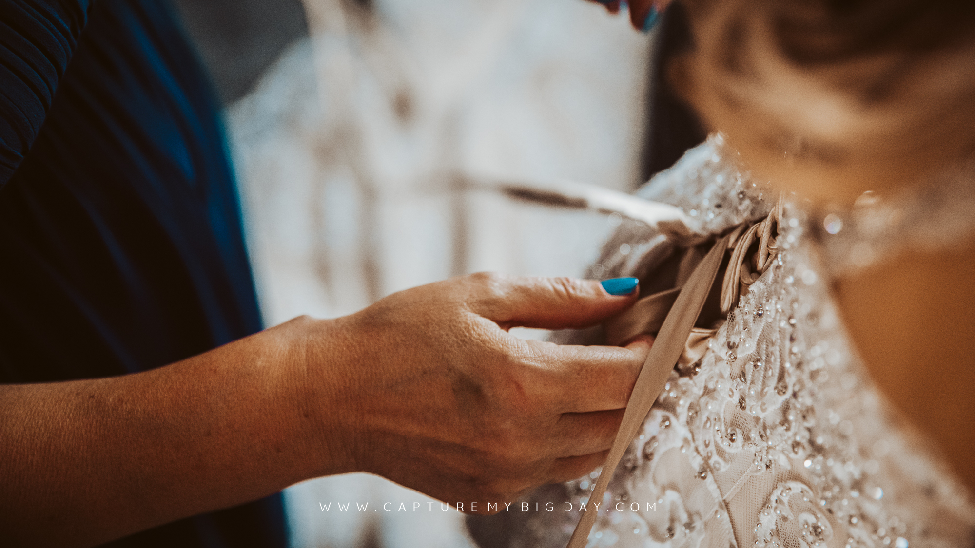 wedding dress being laced up