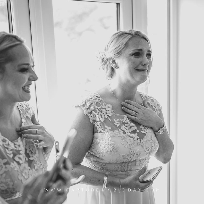 bridesmaids looking at the bride