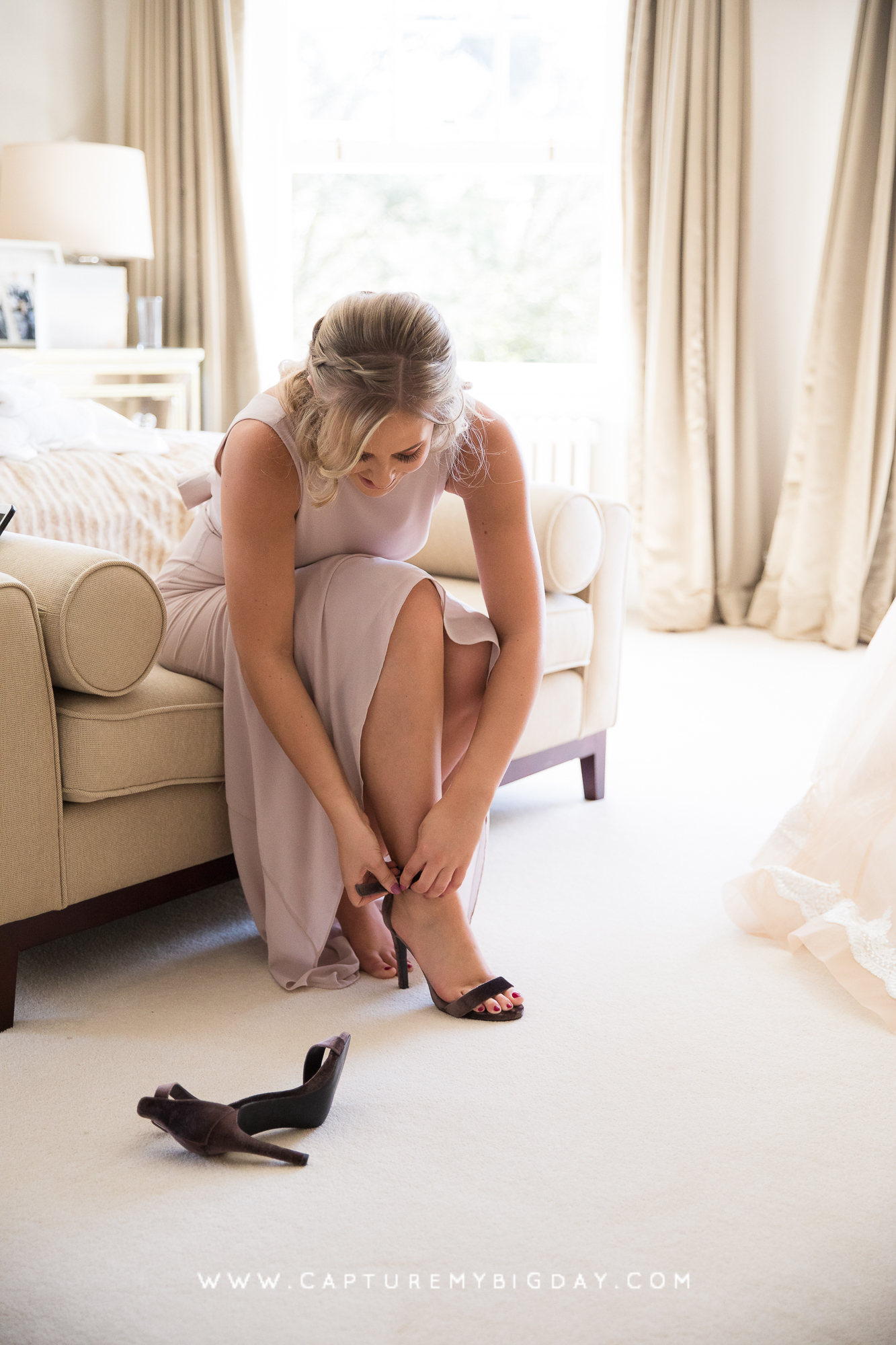 Bridemaid putting her shoes on