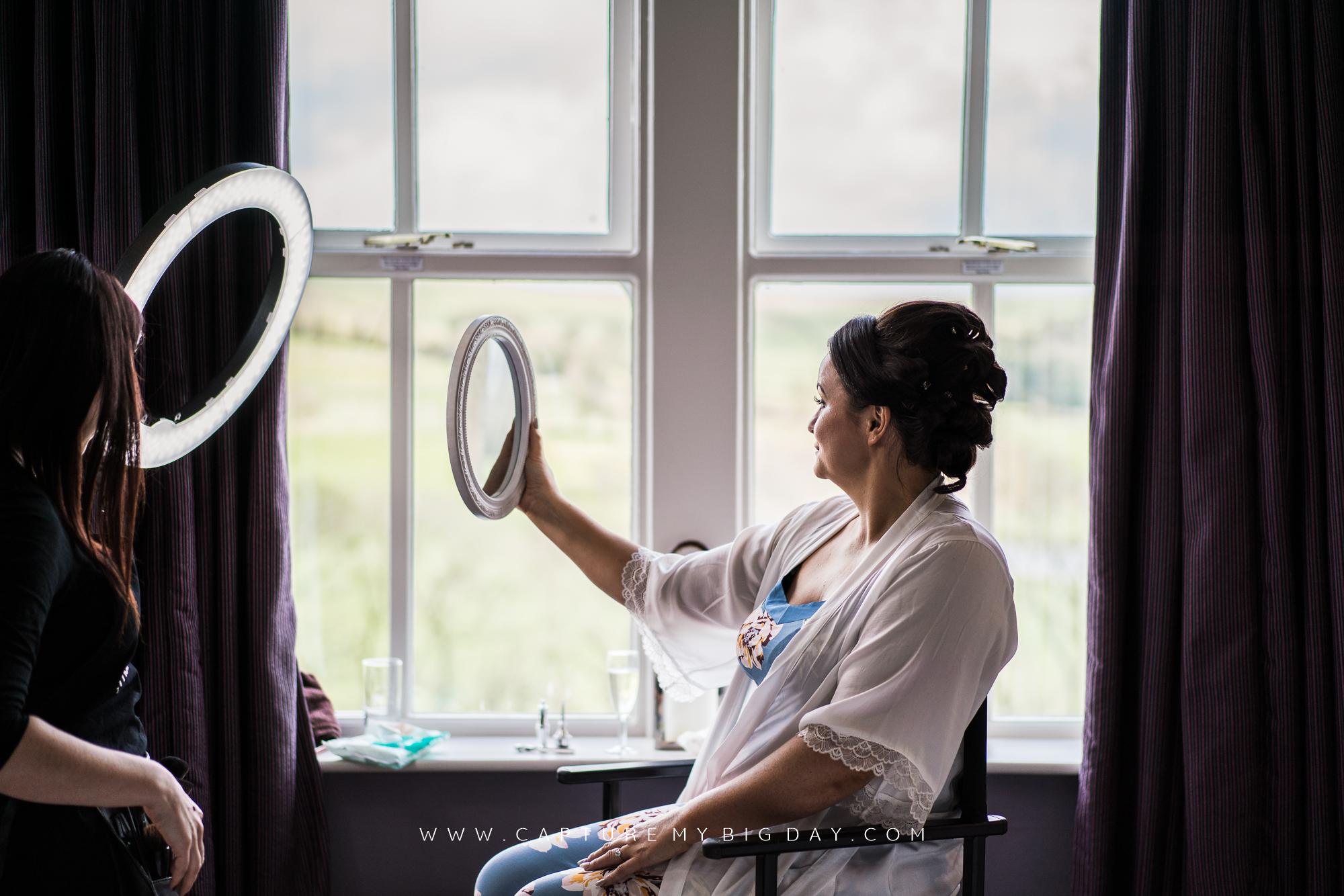 Brides make up in mirror