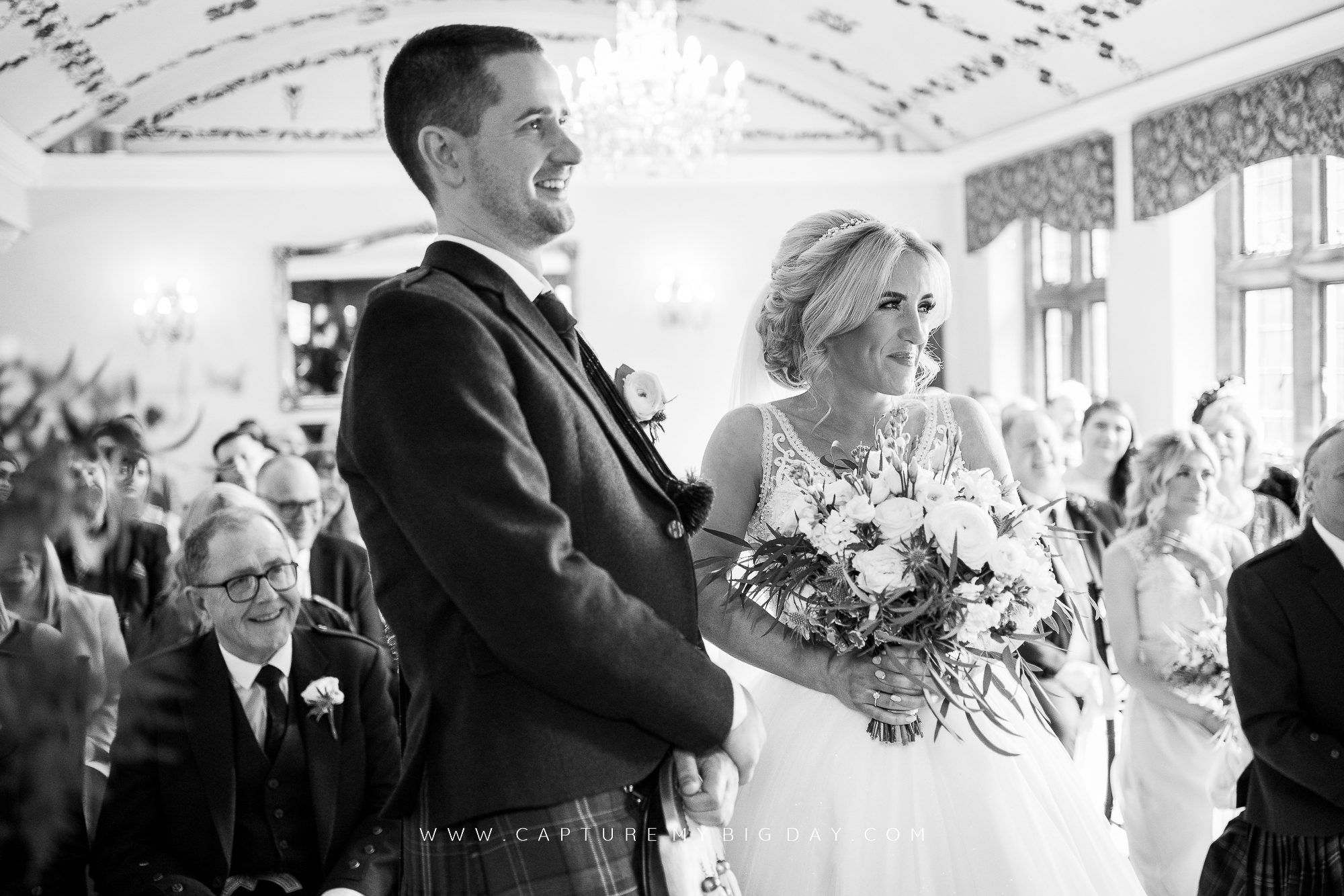 wedding ceremony groom laughing