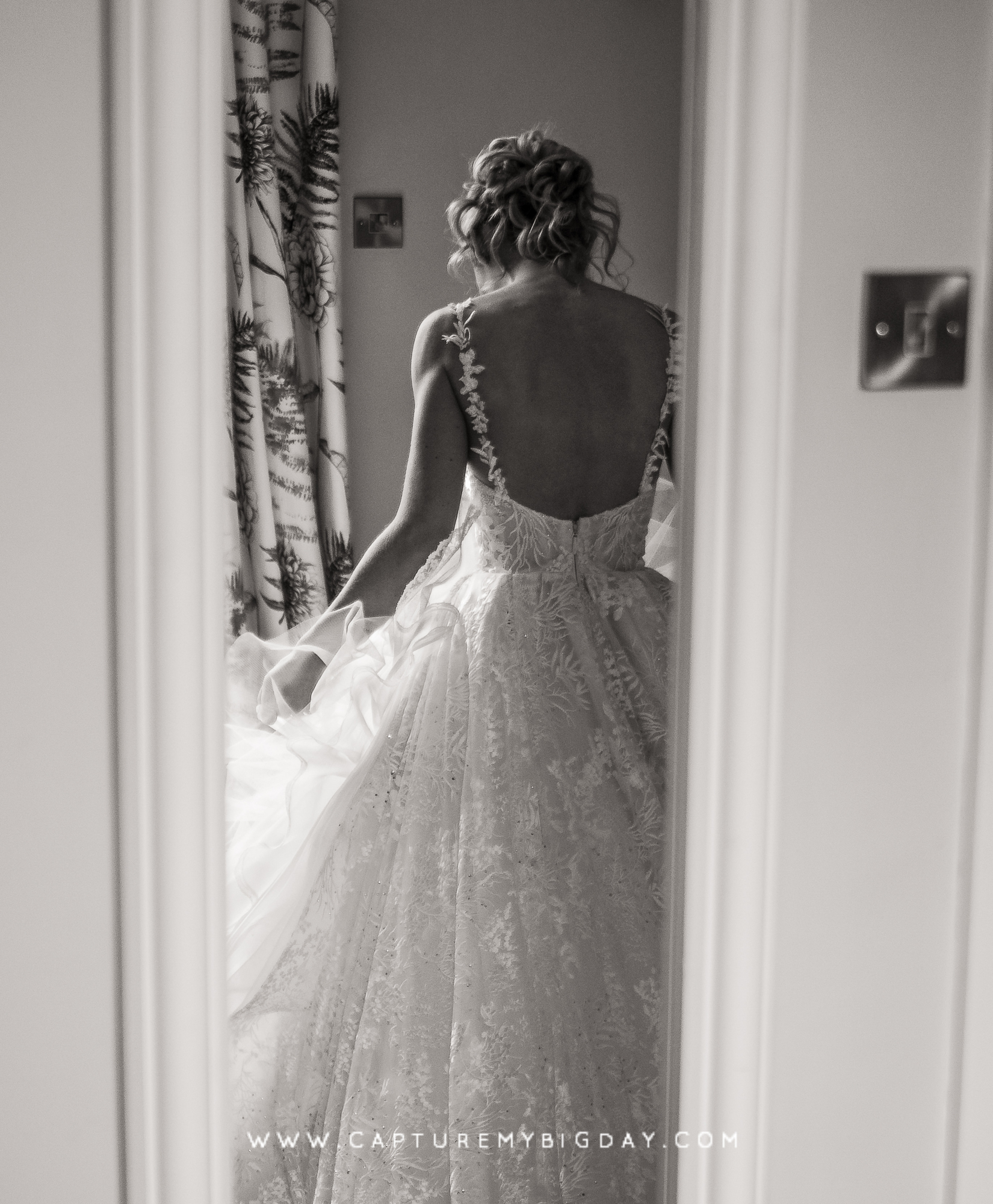 back of brides dress in a mirror