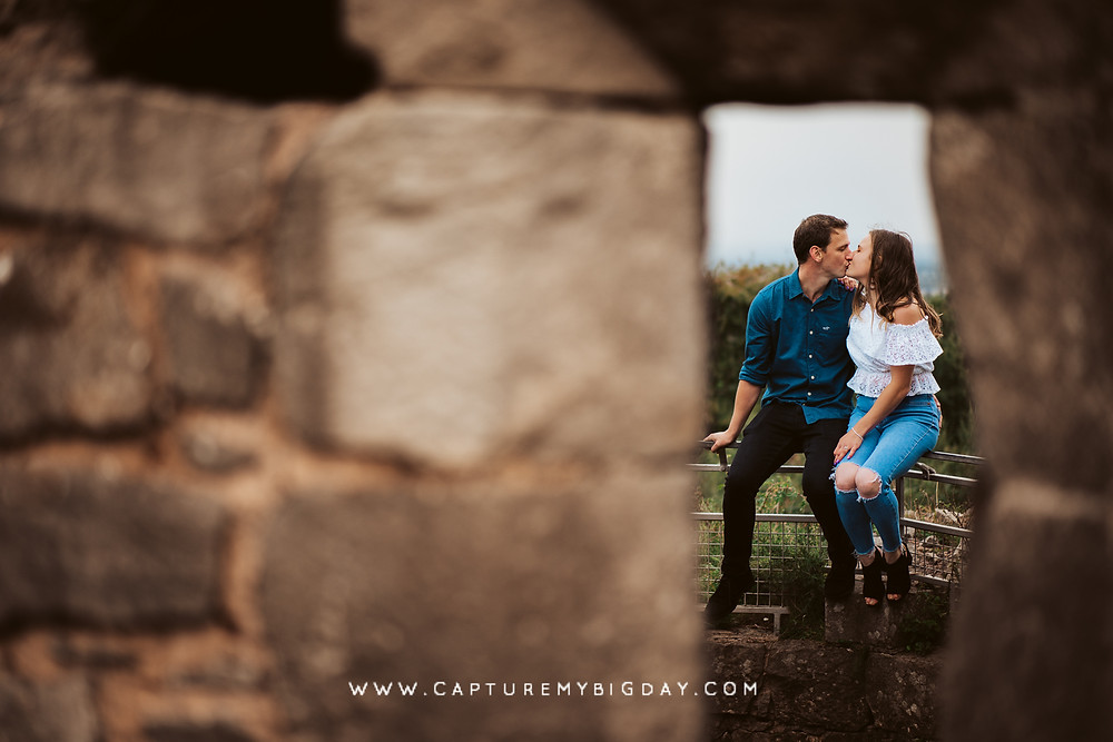 couple kissing by the castle