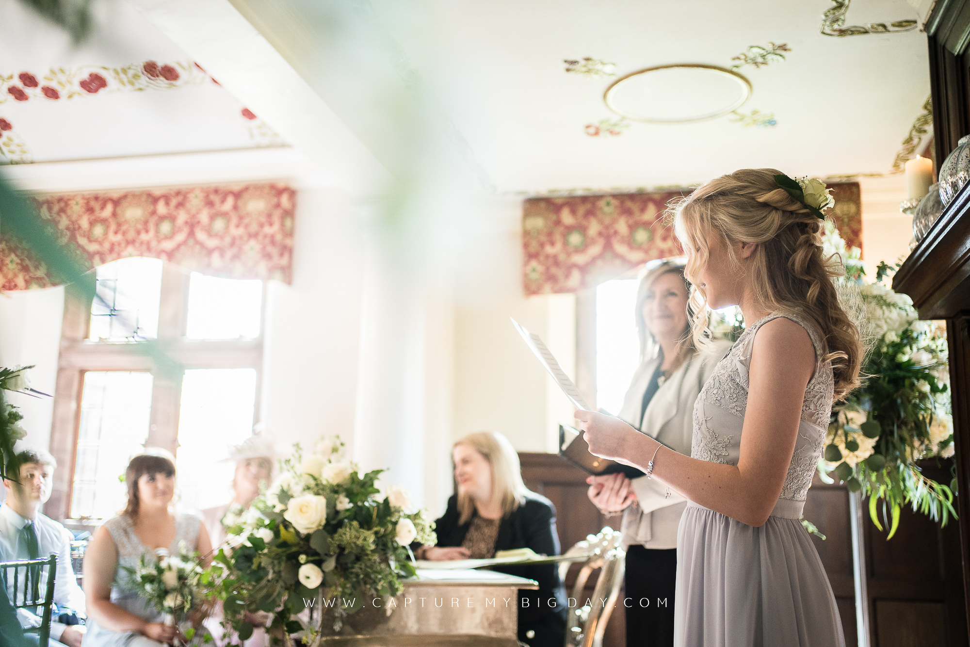 bridesmaid doing a reading at ceremony