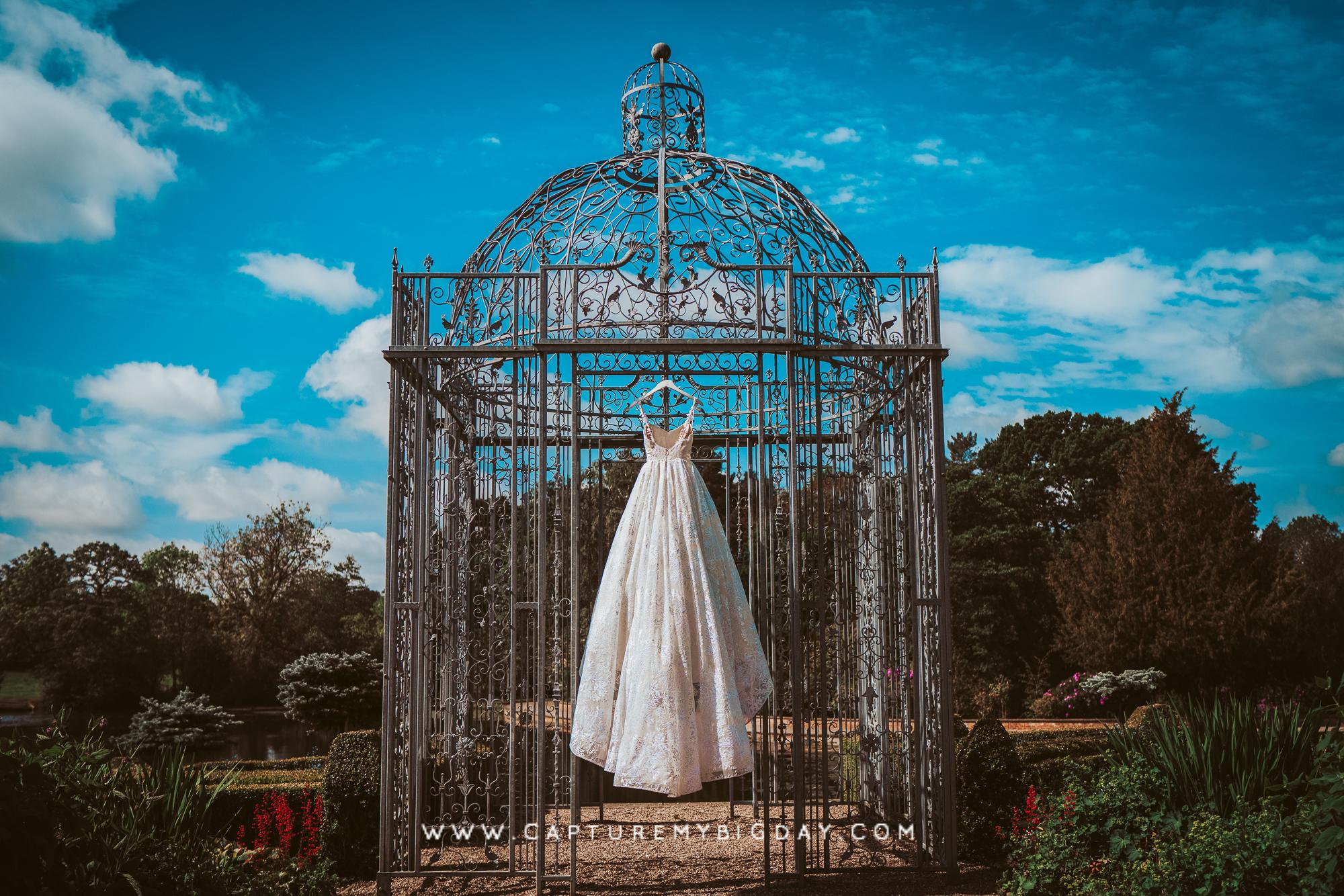 Wedding dress hanging outside Capesthorne Hall