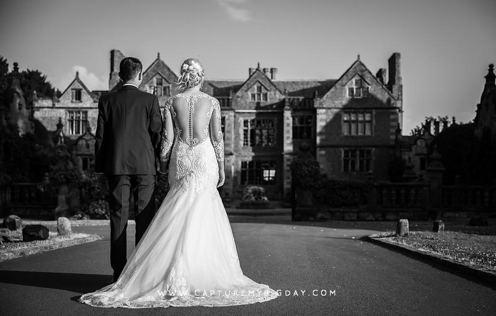 bride and groom walking towards Dorfold Hall