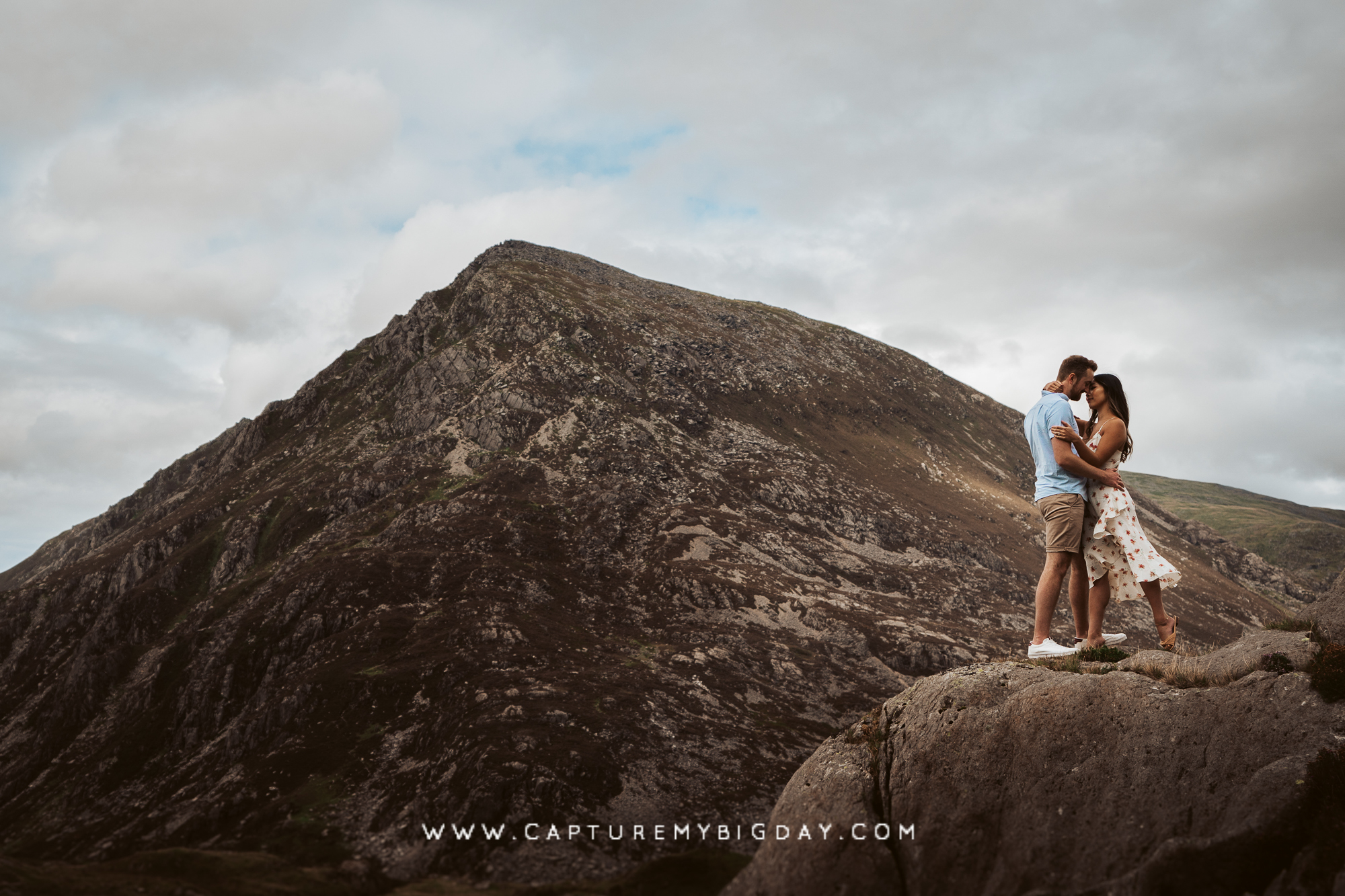 engagement photograph on a rock