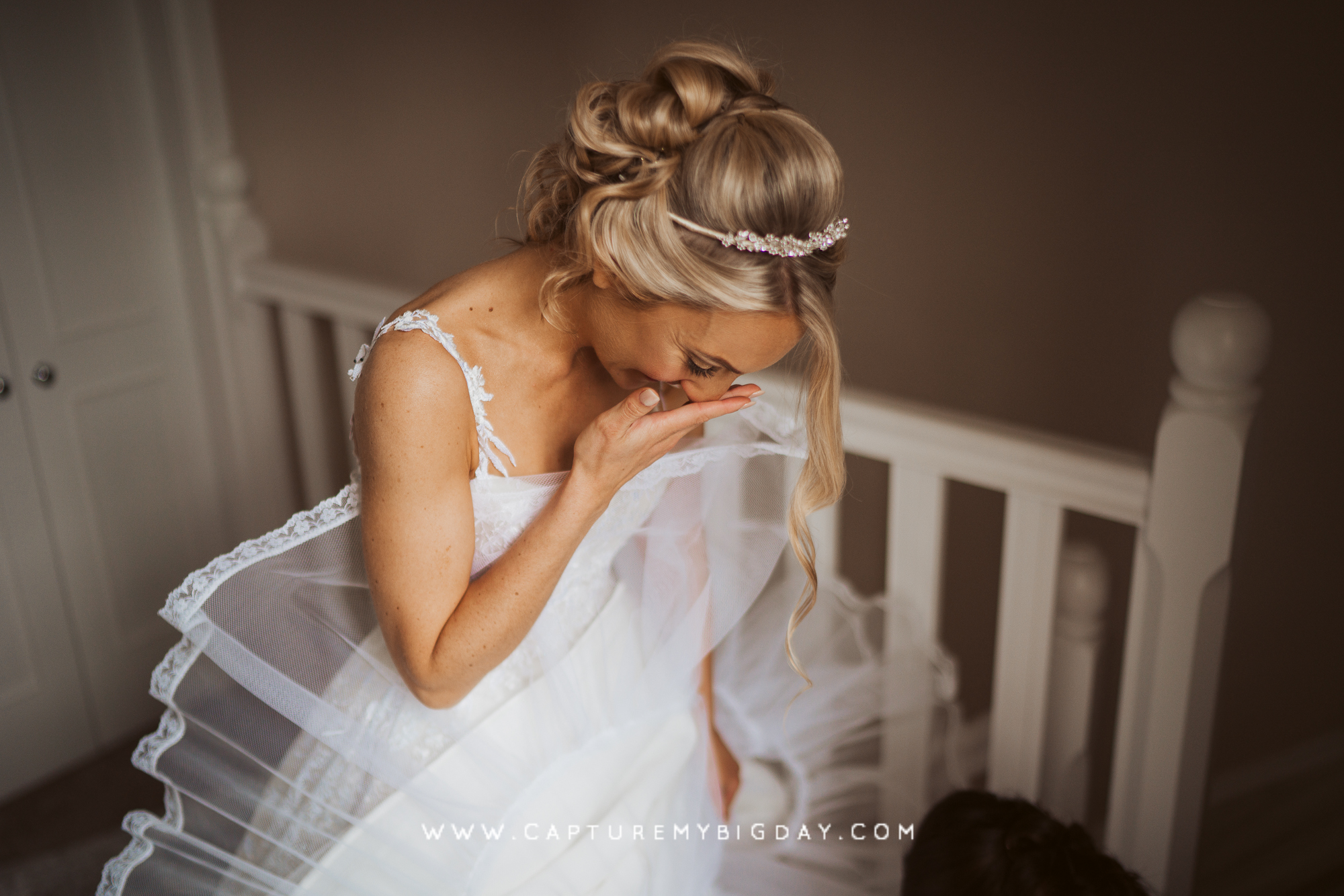 Bride in her wedding dress with underskirt sticking out