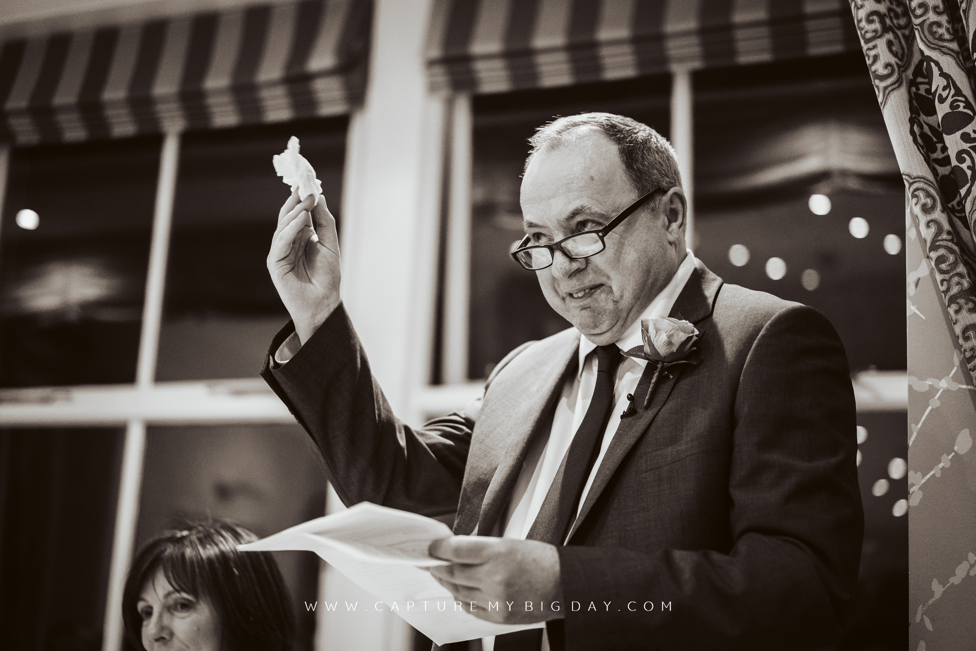 father of the bride holding a tissue with speeches