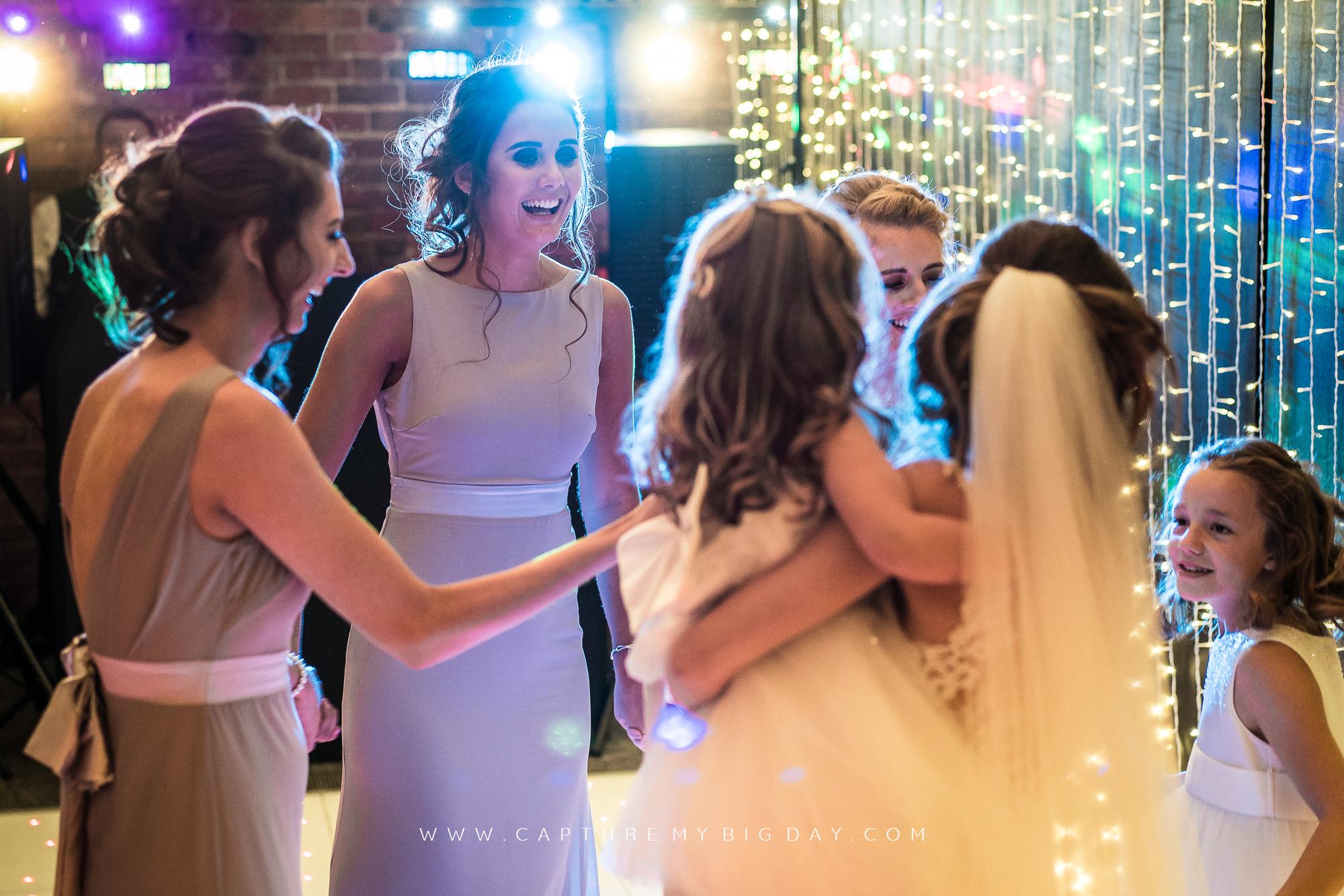 bridesmaids on dance floor