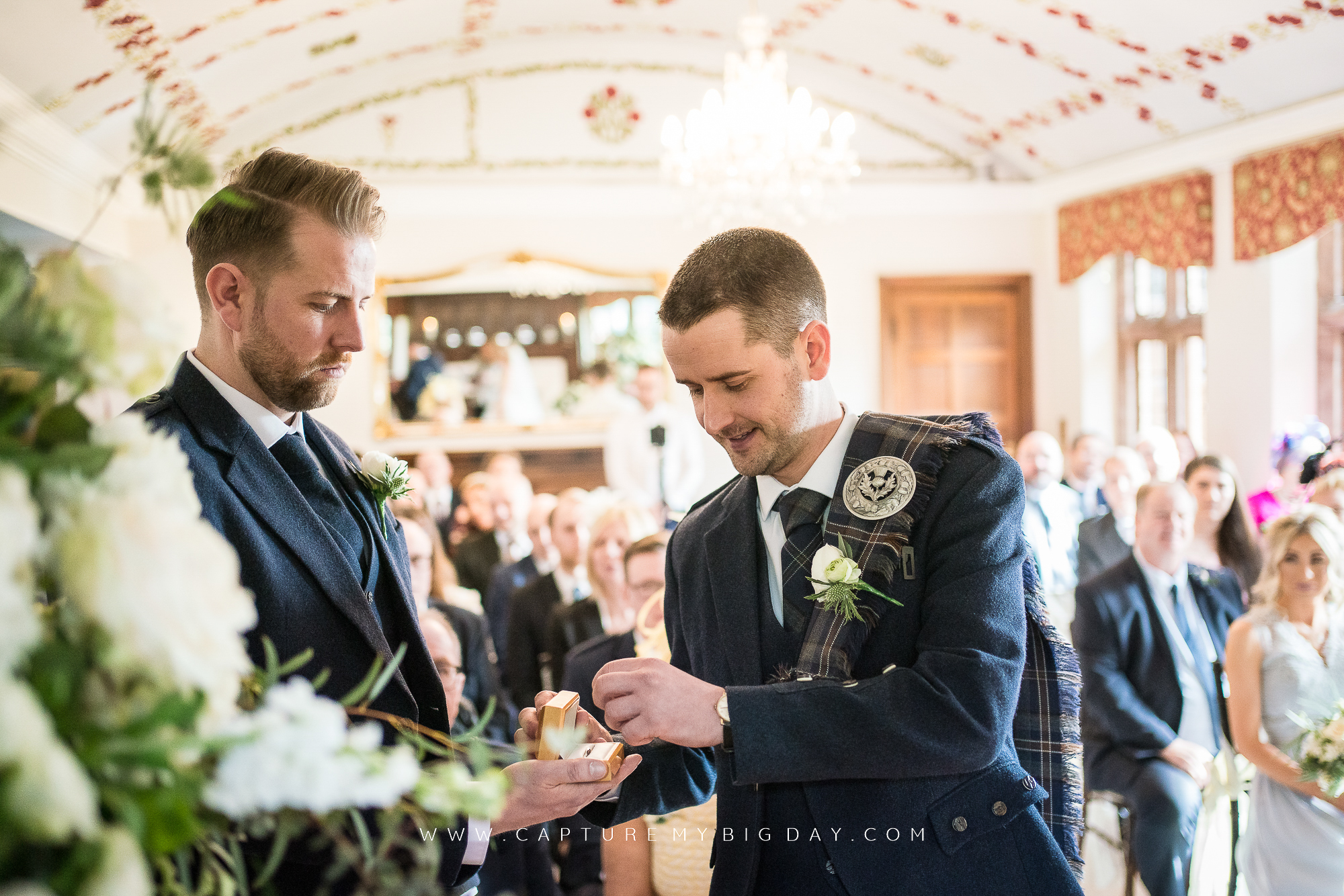 groom collecting ring in ceremony