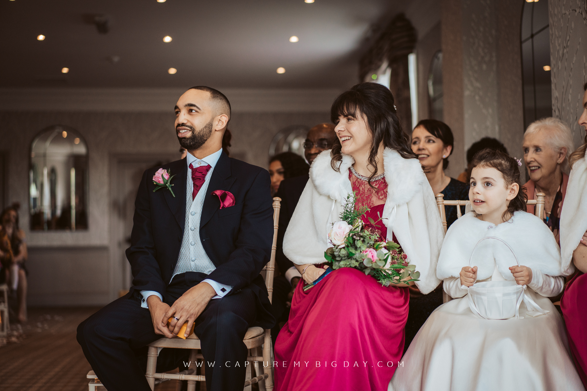wedding guests smiling in ceremony