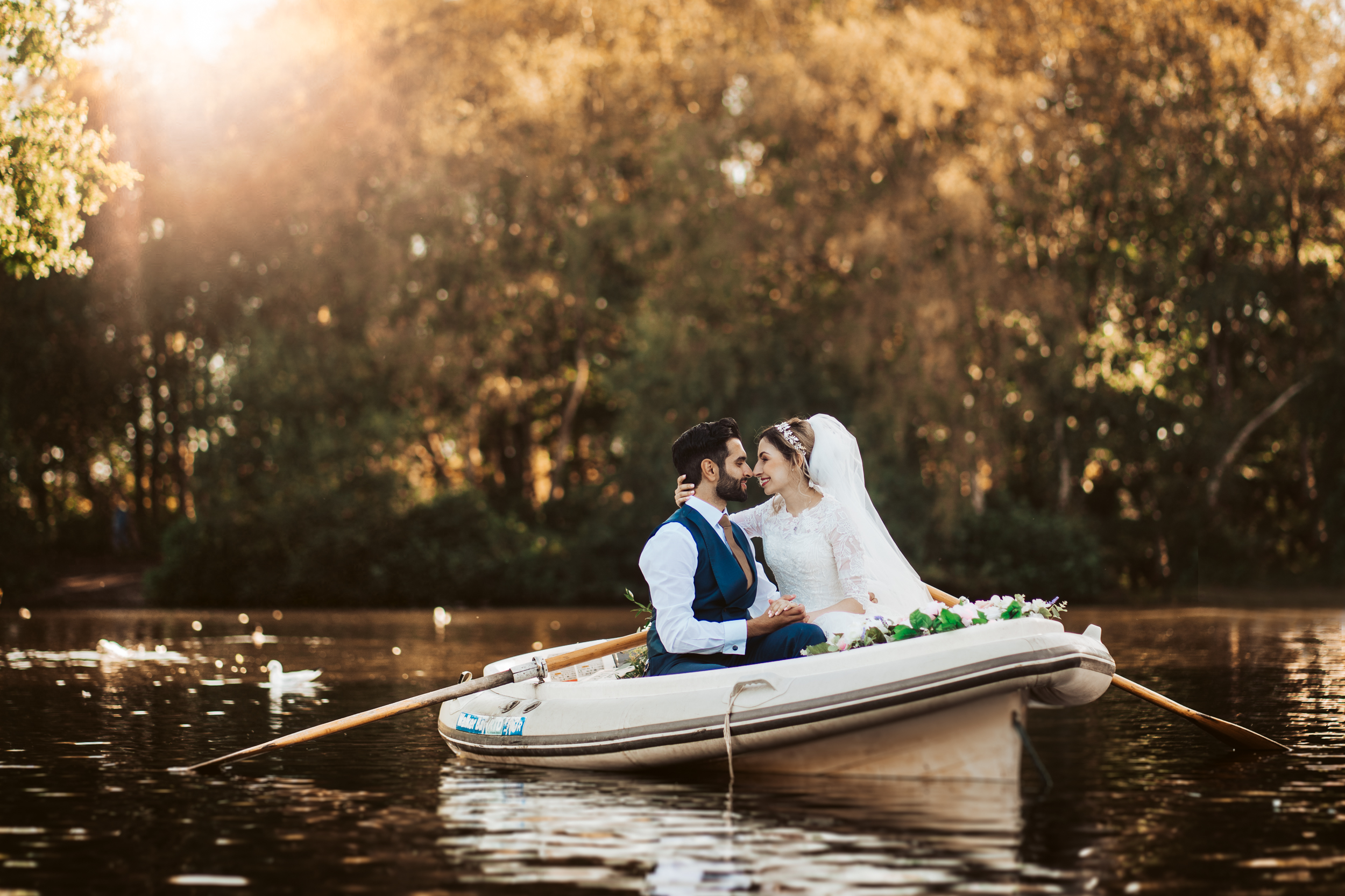 bride and groom on the lake