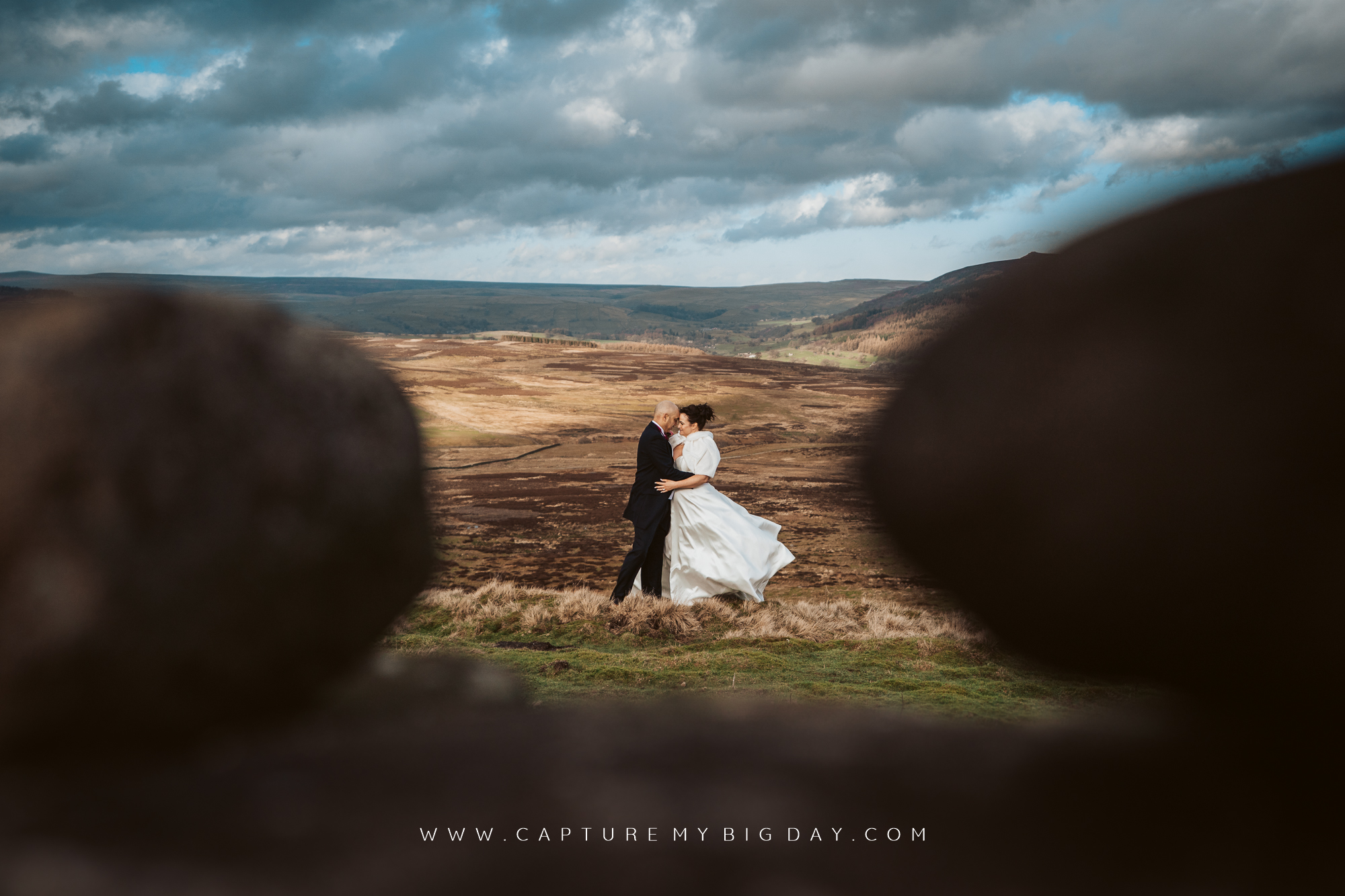 bride and groom up windy hill