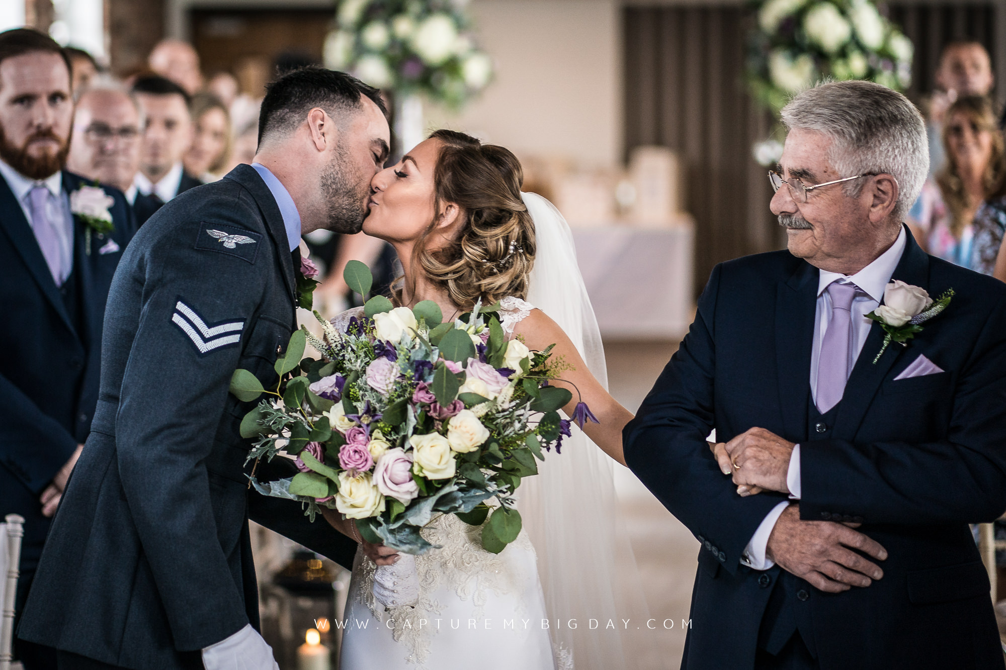 bride kissing the groom