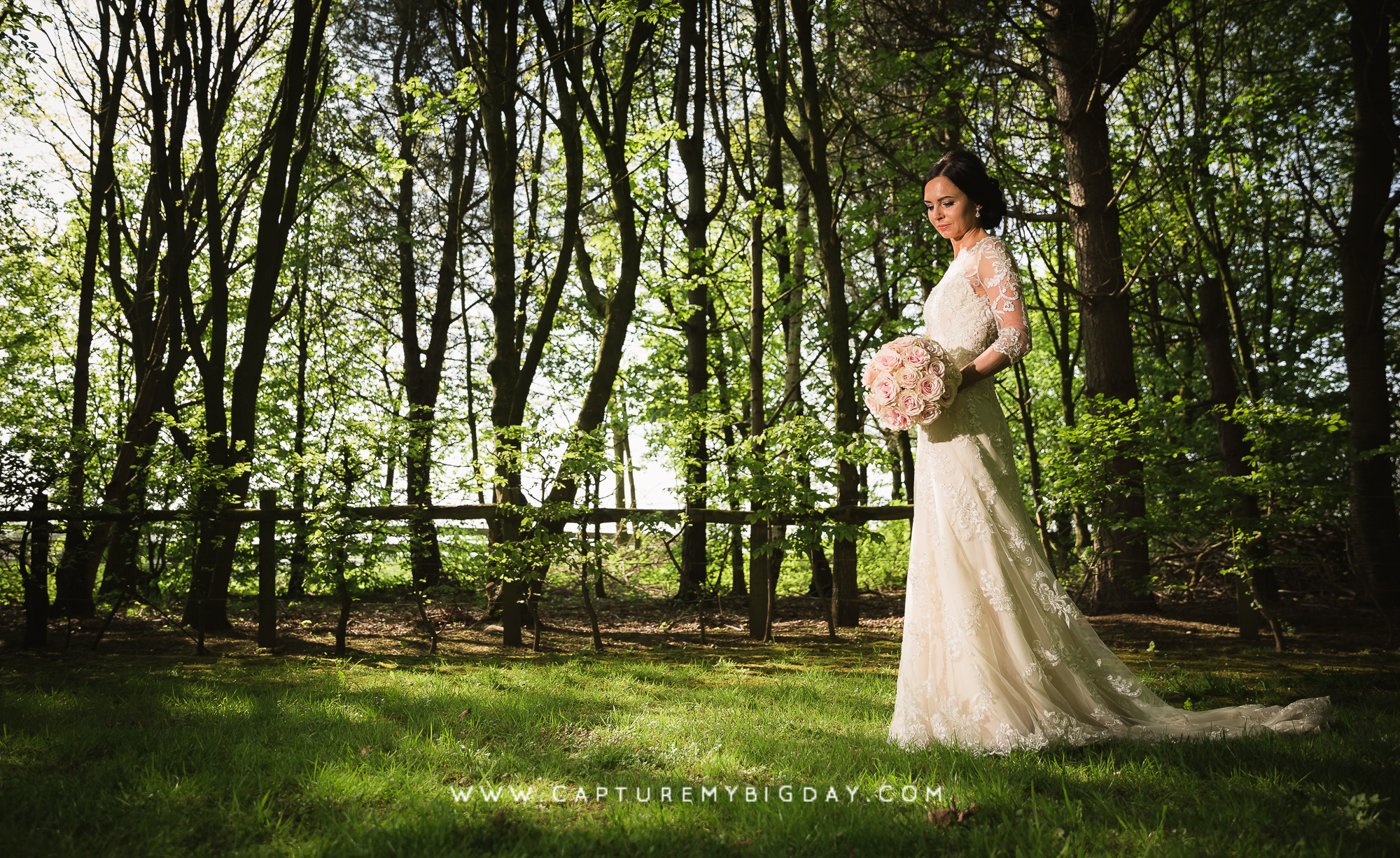 Bride standing in the woodlands
