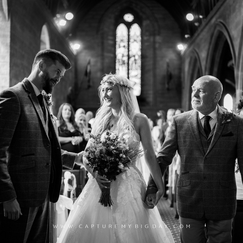 father giving the bride away