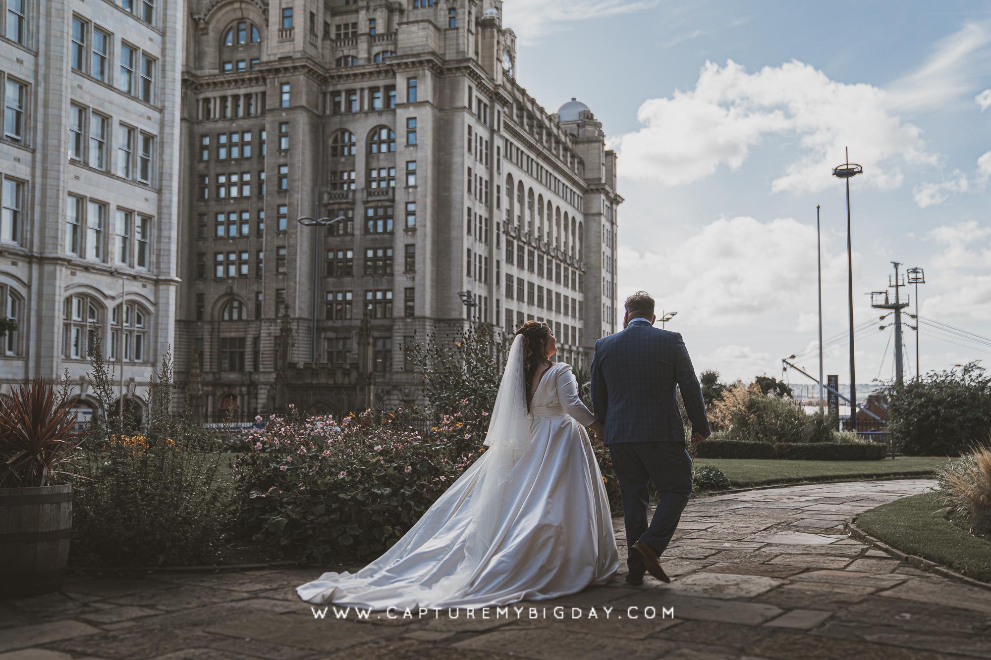 bride and groom walking to Liverpool docks