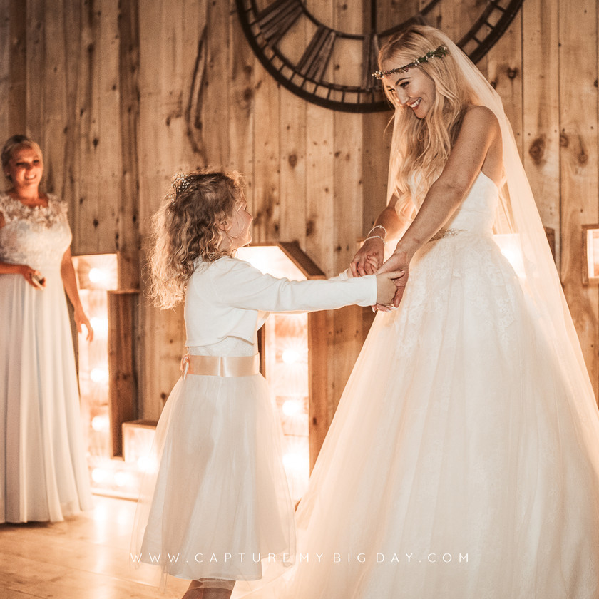 bride dancing with the flower girl
