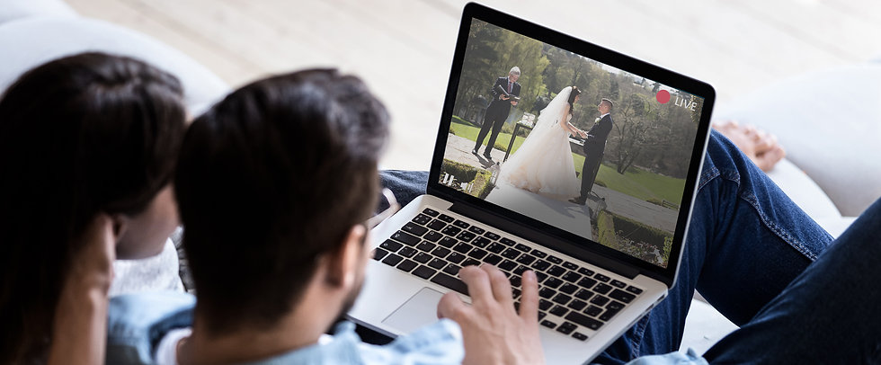 Live streaming wedding watched through a laptop
