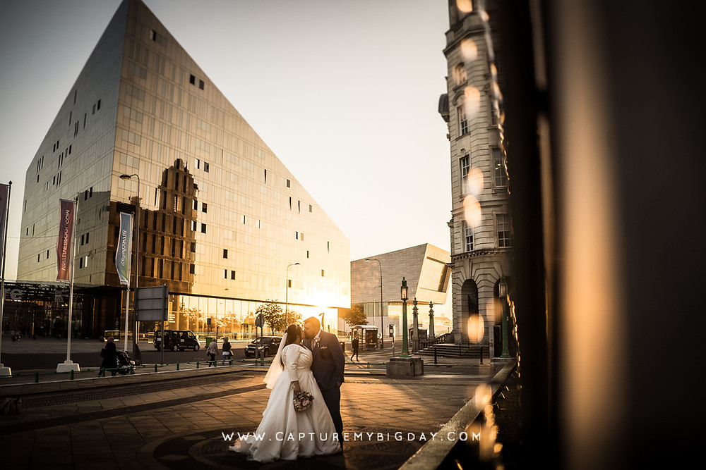 Bride and groom outside 30 James street in sunset