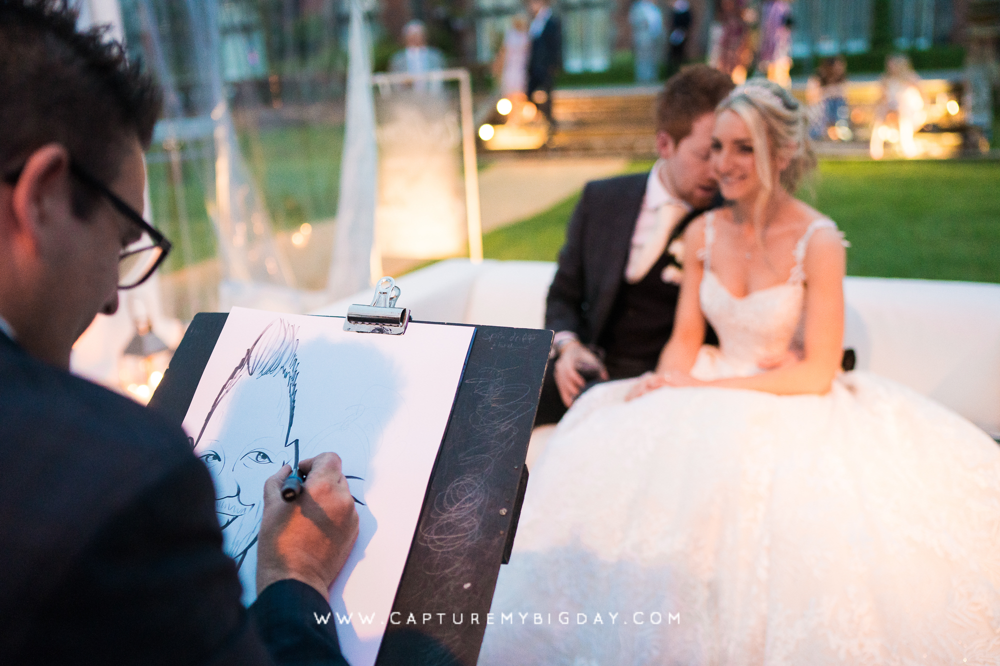bride and groom having there picture drawn