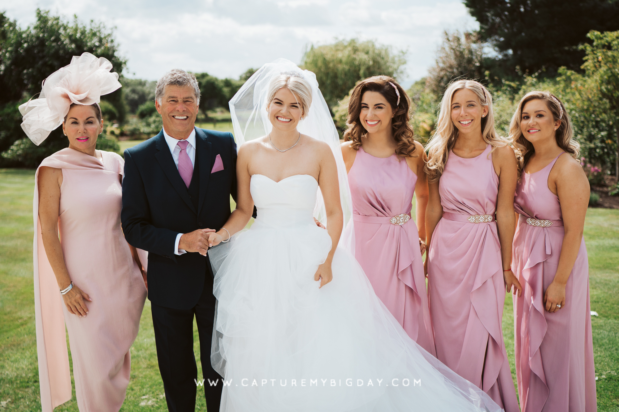 Bride with her parents and bridesmaid