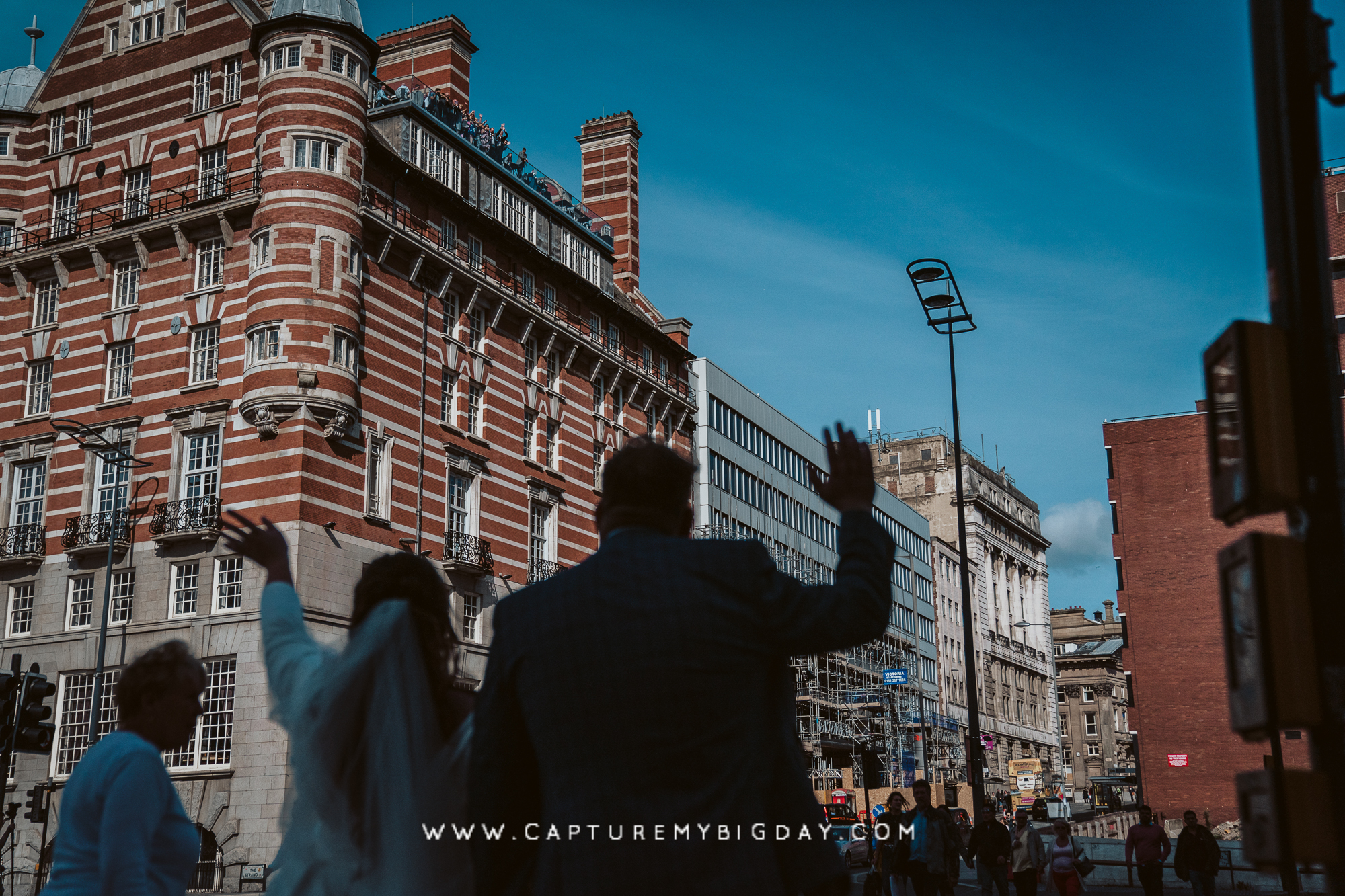 wedding guests waving from 30 James street