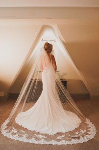 bride in dress with veil in room alone