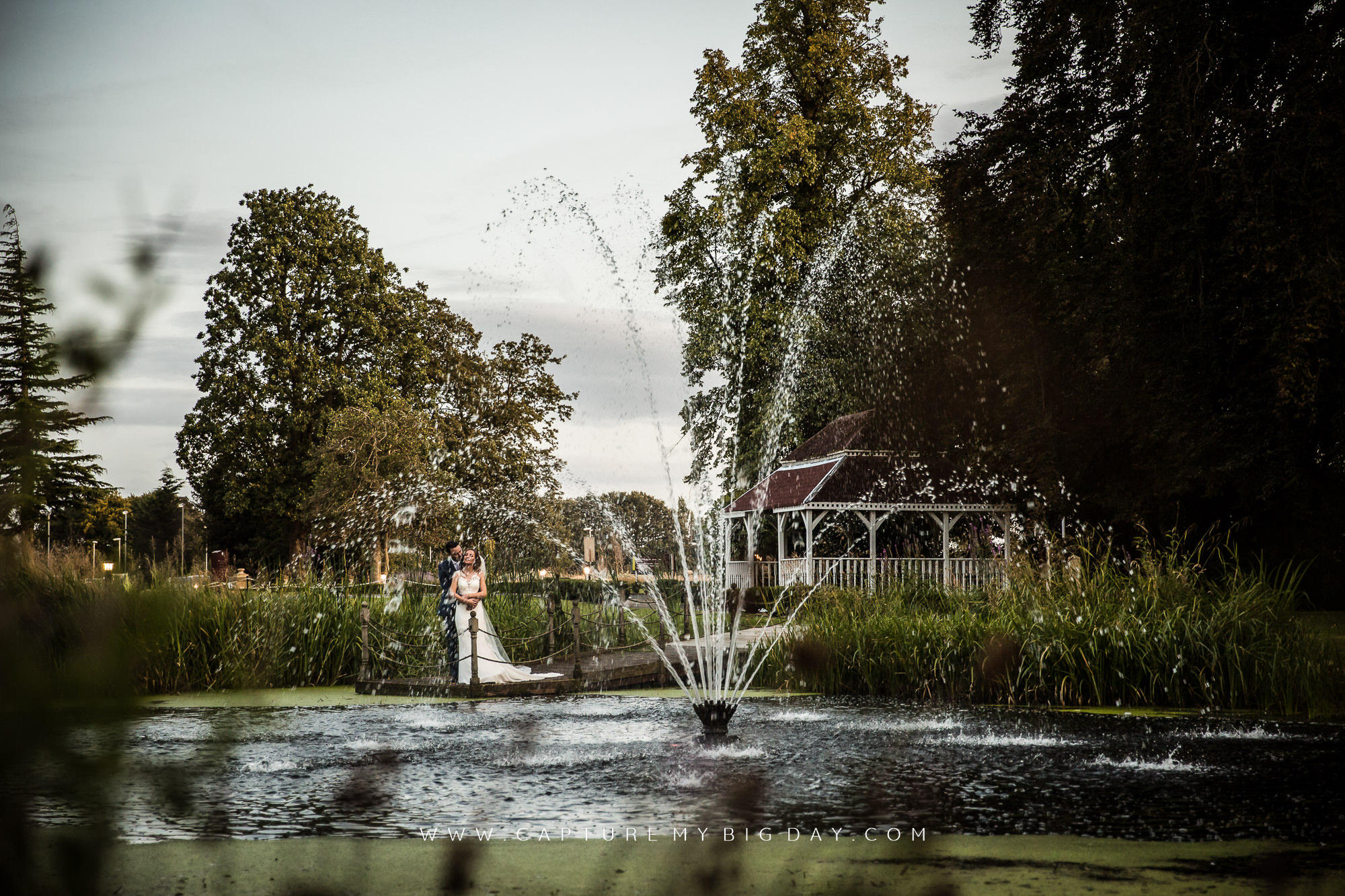 bride and groom by the water