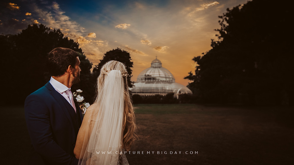 Evening wedding photograph at Sefton Park Palm house