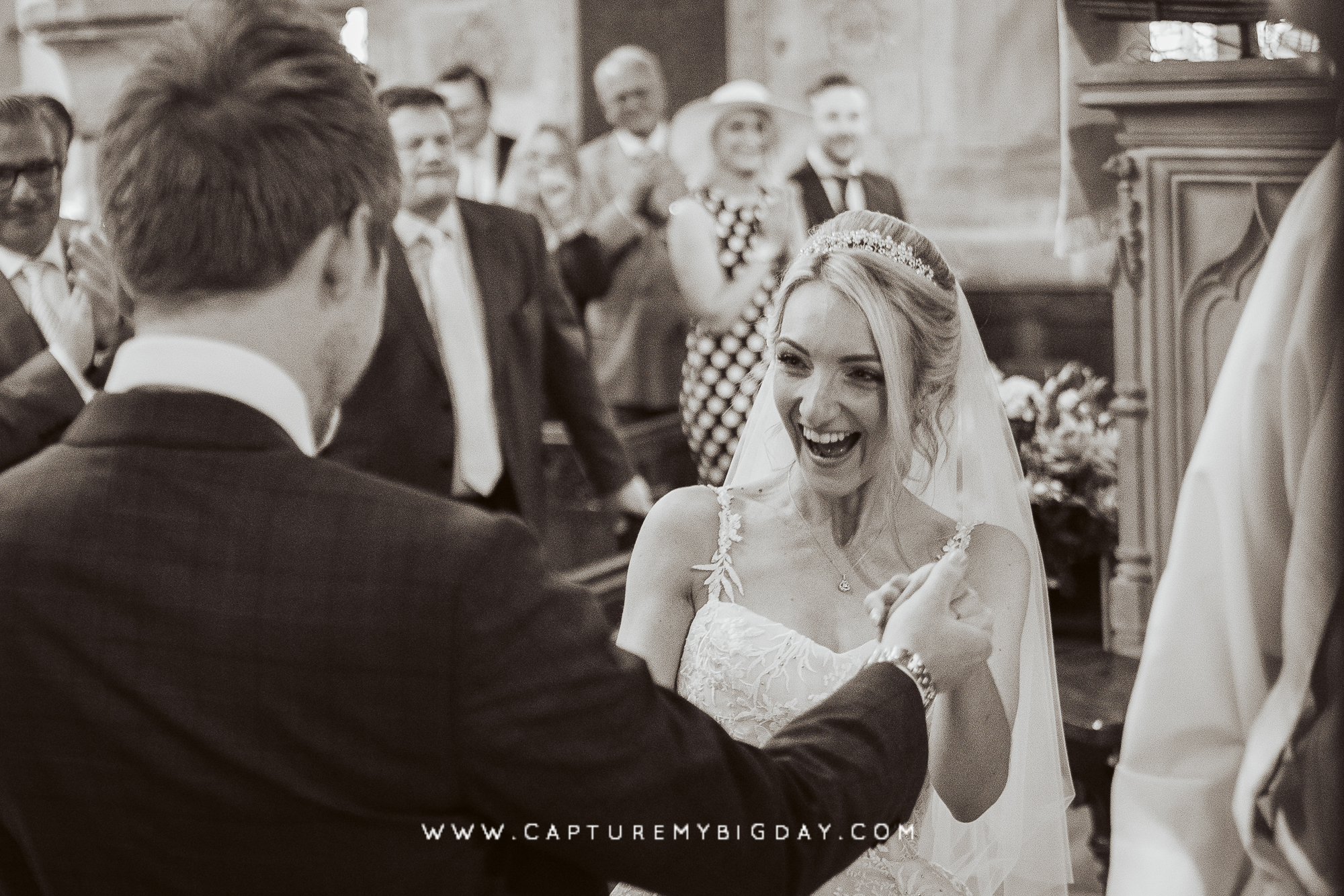 bride smiling with in church