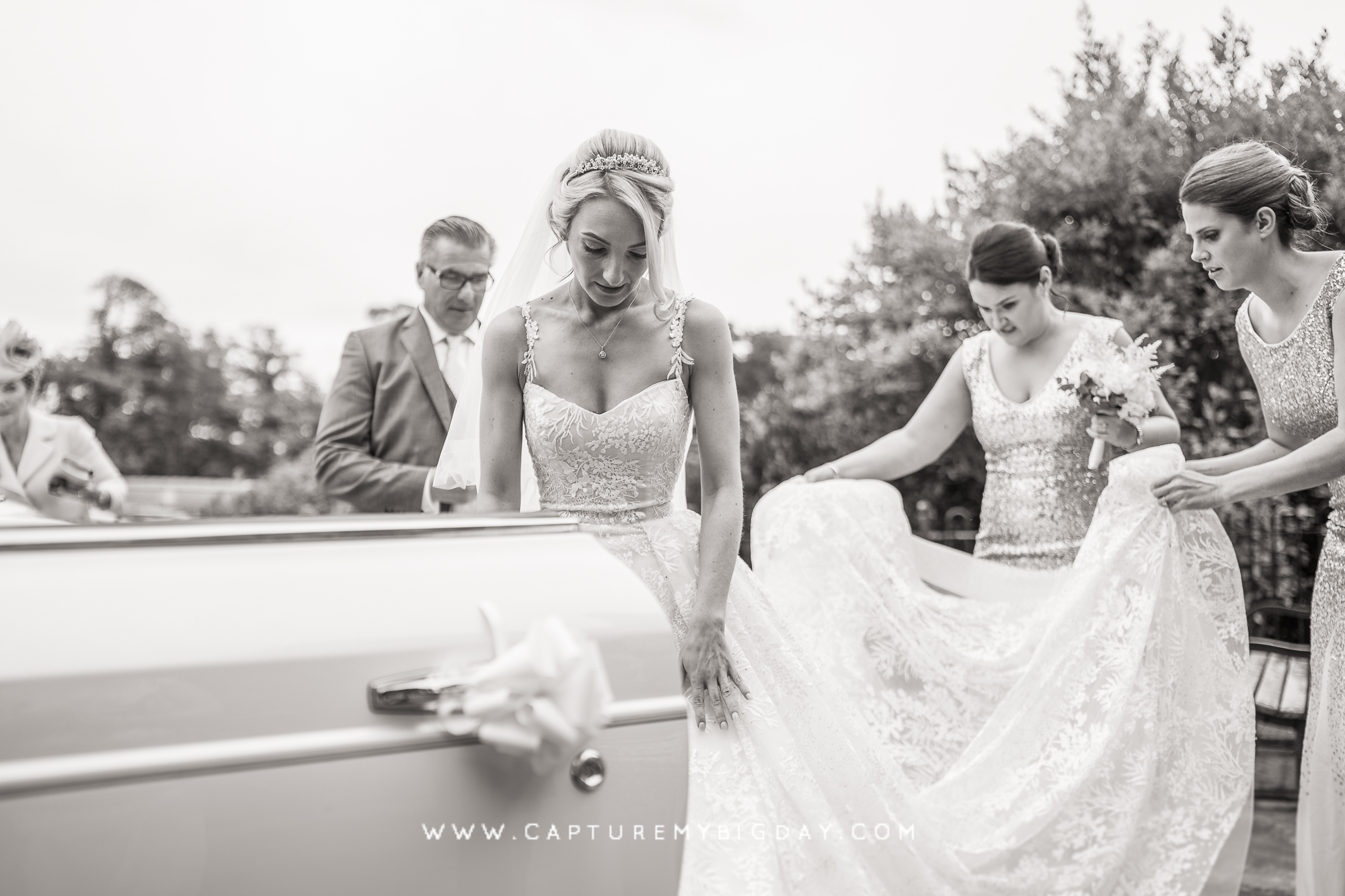 bride getting out of wedding dress