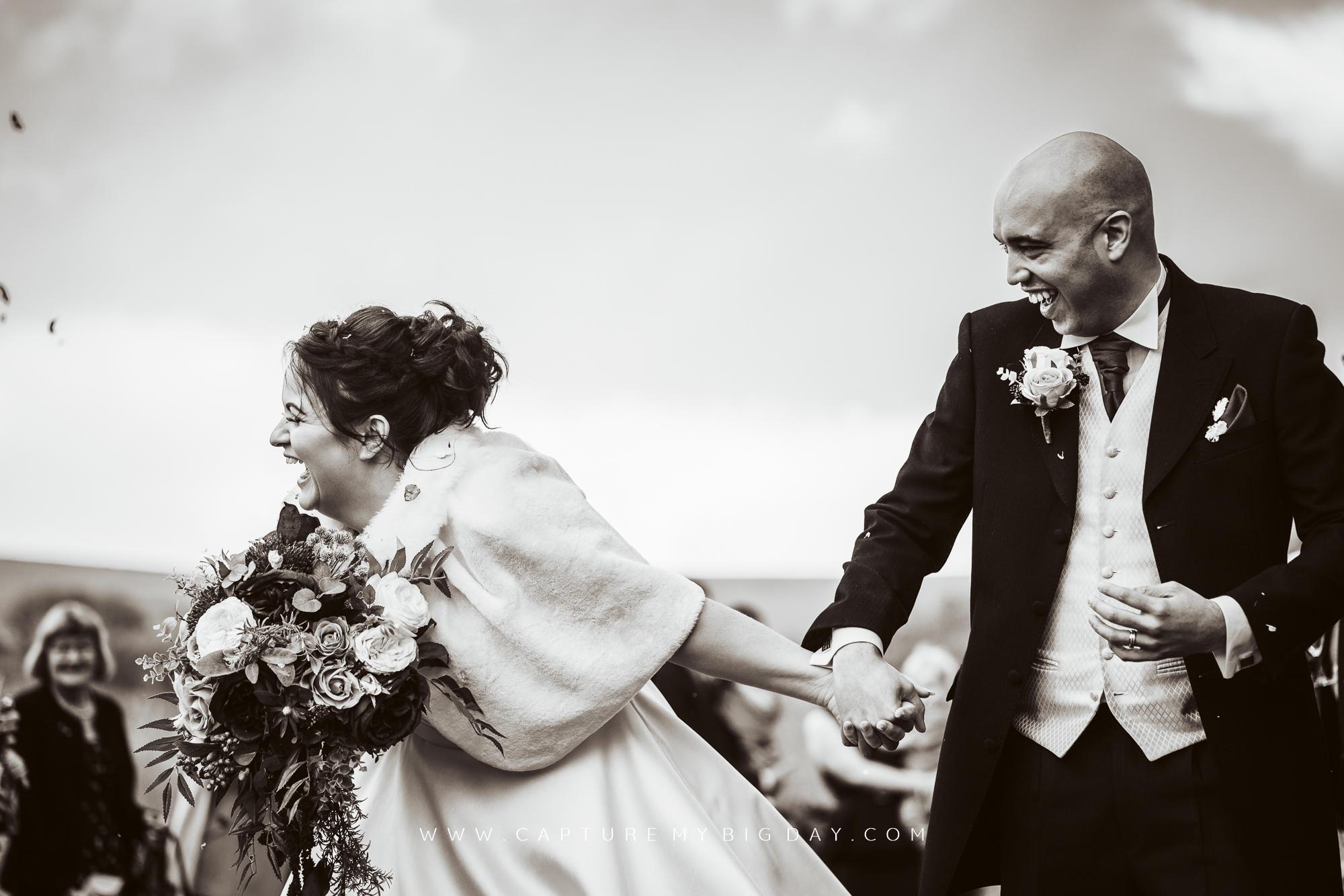 bride laughing in confetti