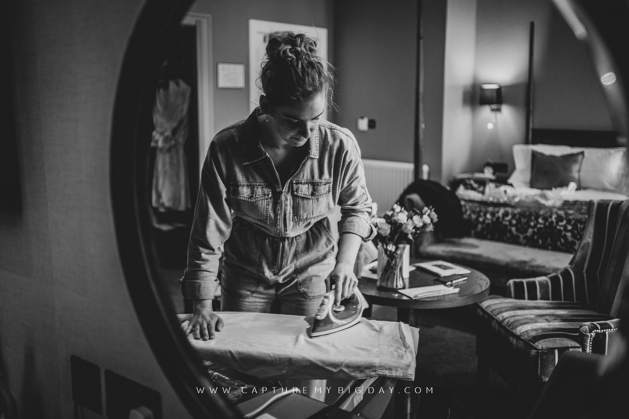 bride ironing wedding shirt