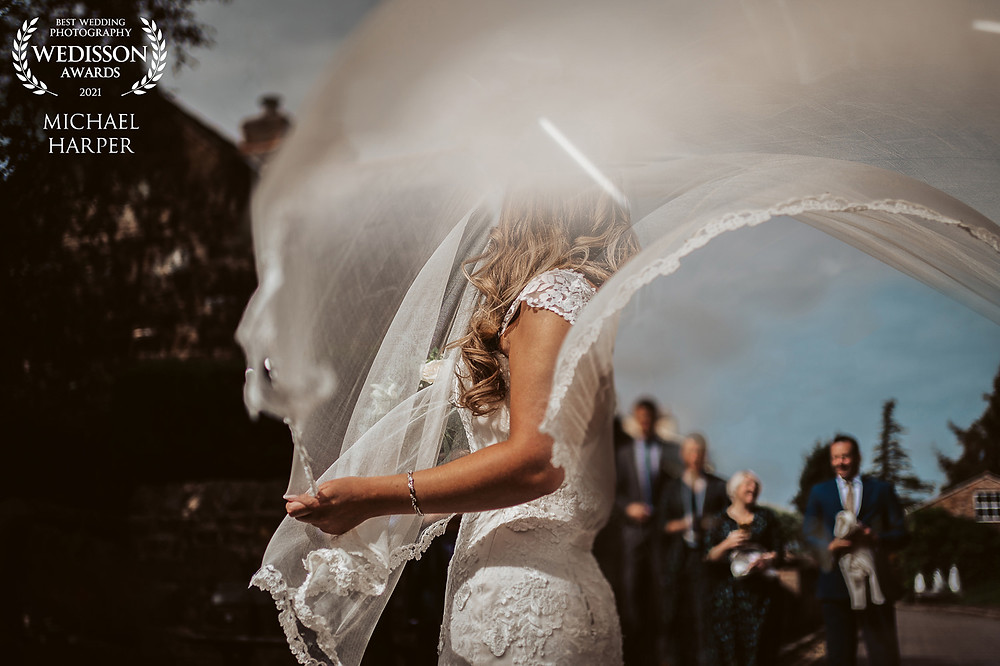 Brides veil blowing in the wind, mix of light, award won