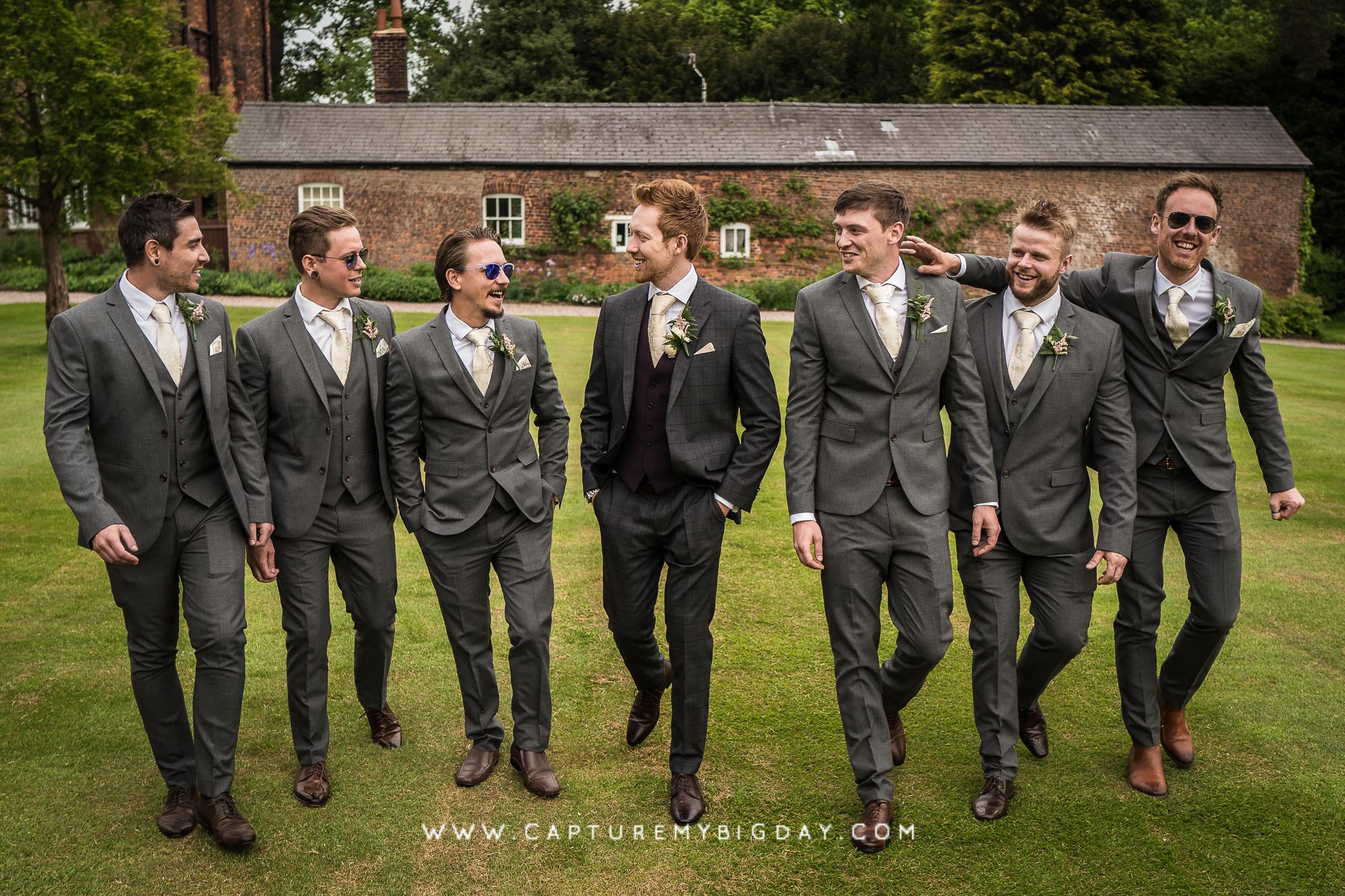 groom walking with grooms men