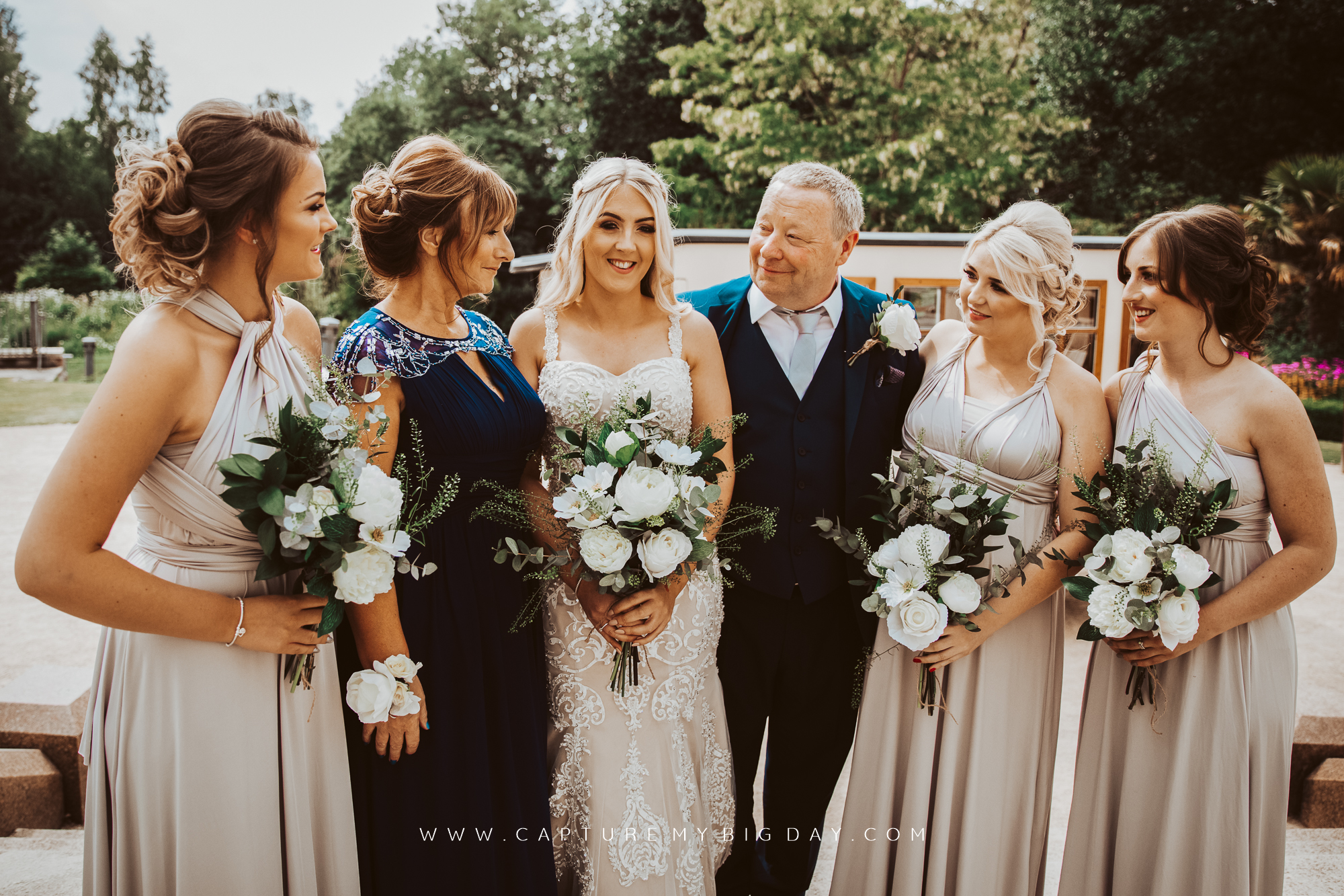 Bride with her family and bridesmaids