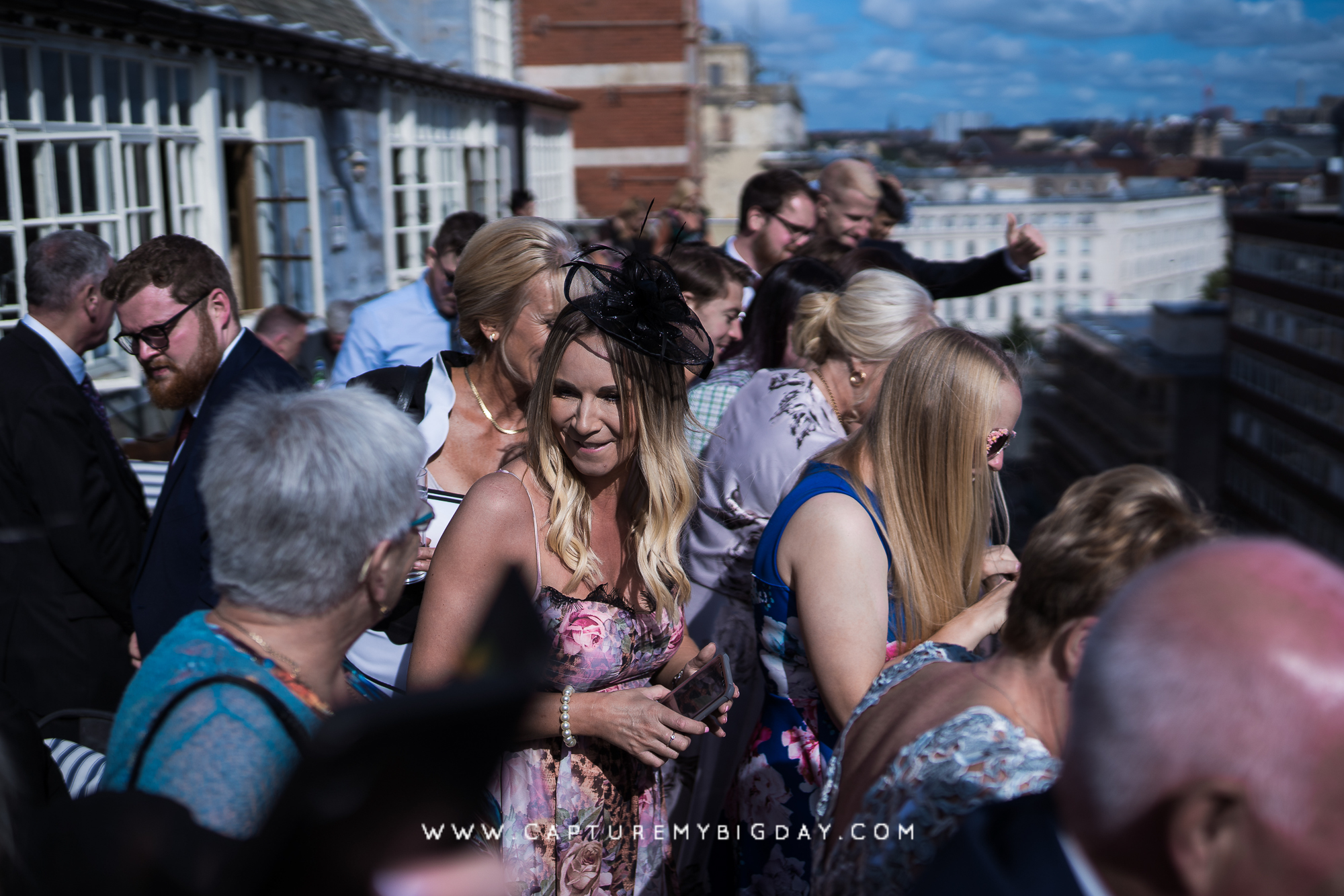 wedding guests watching bride and groom from top of 30 James Street