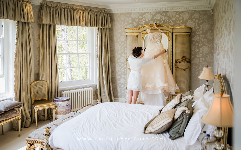 Bride checking her wedding dress at Delamere Manor