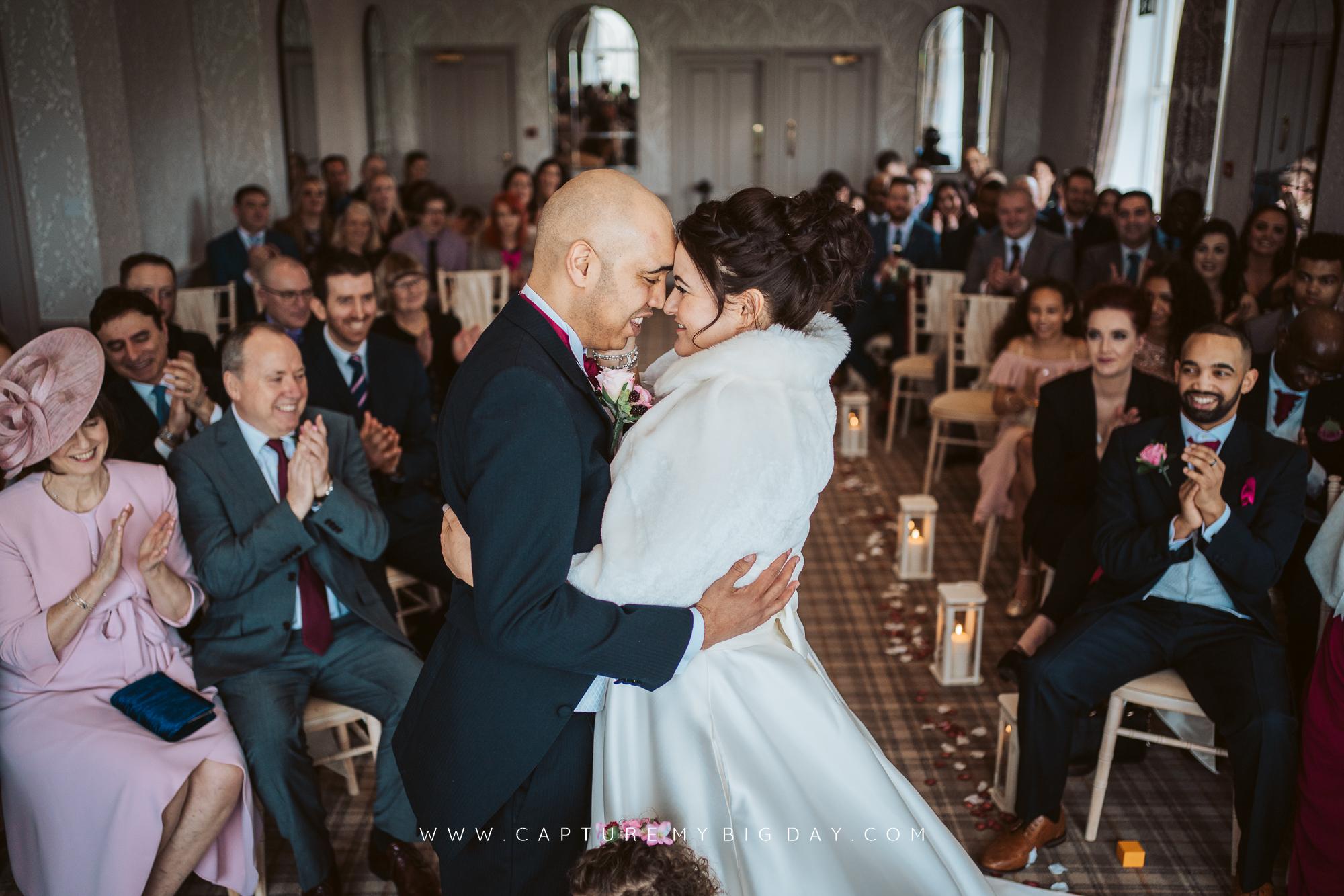 bride and groom hugging in wedding ceremony