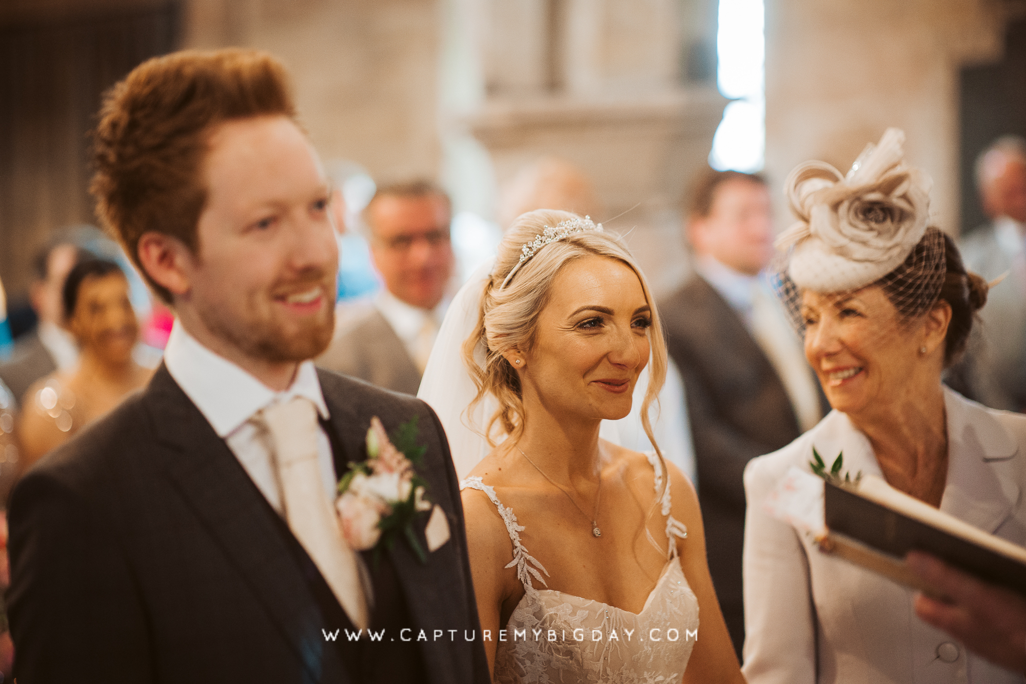 Bride smiling in church with groom
