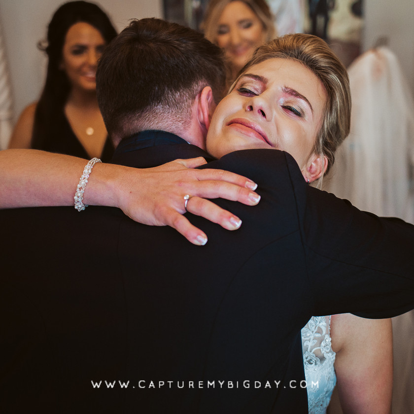 bride hugging brother