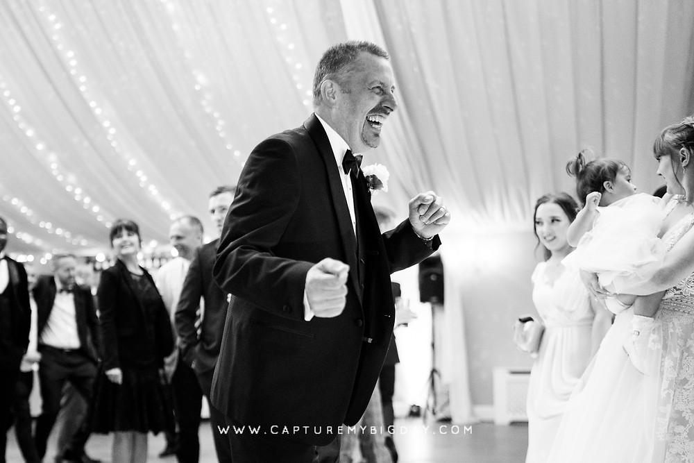 Man dancing at wedding venue